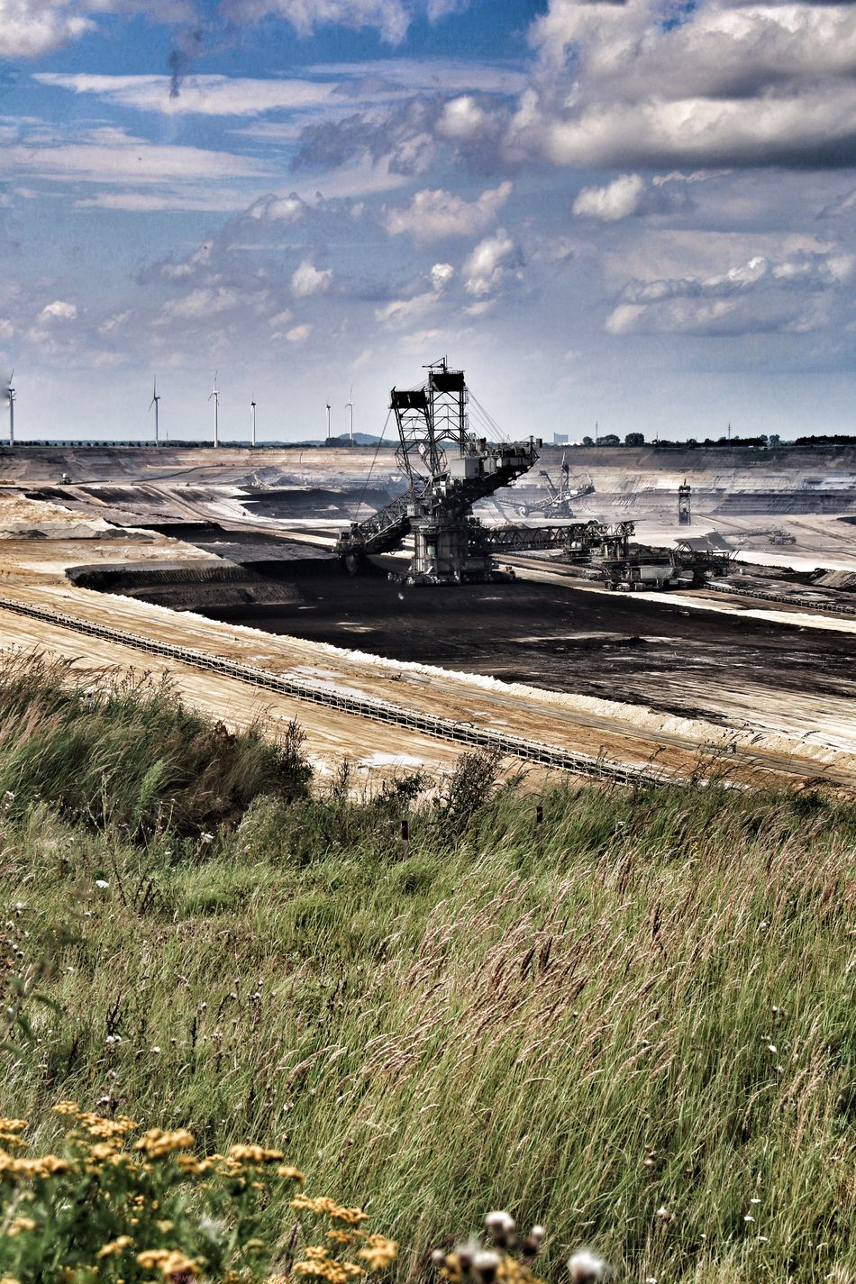 Brown coal surface mining - open cast coal mining. Huge bucket wheel excavator. new developed technology. Supposed to be more environmentally friendly. Bucket Wheel Excavator Cloud - Sky Grass Gravel Industry No People Non-urban Scene Open Cast Coal Mining Outdoors Sky