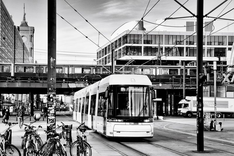 Architecture Berlin_streetphoto Building Exterior Built Structure City Connection Day Land Vehicle Mode Of Transport Outdoors Public Transportation Rail Transportation Railroad Track Sky Tram Transportation Travel Travel Destinations