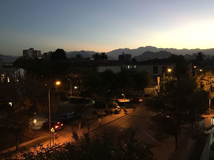 Illuminated Building Exterior City Night Built Structure Street Light Tree Dusk Sky Outdoors Road Mountain No People Cityscape Beauty In Nature Backgrounds My City Silhouette IPhone Dawn Of A New Day The Purist (no Edit, No Filter) Scenics Dawn Tranquility
