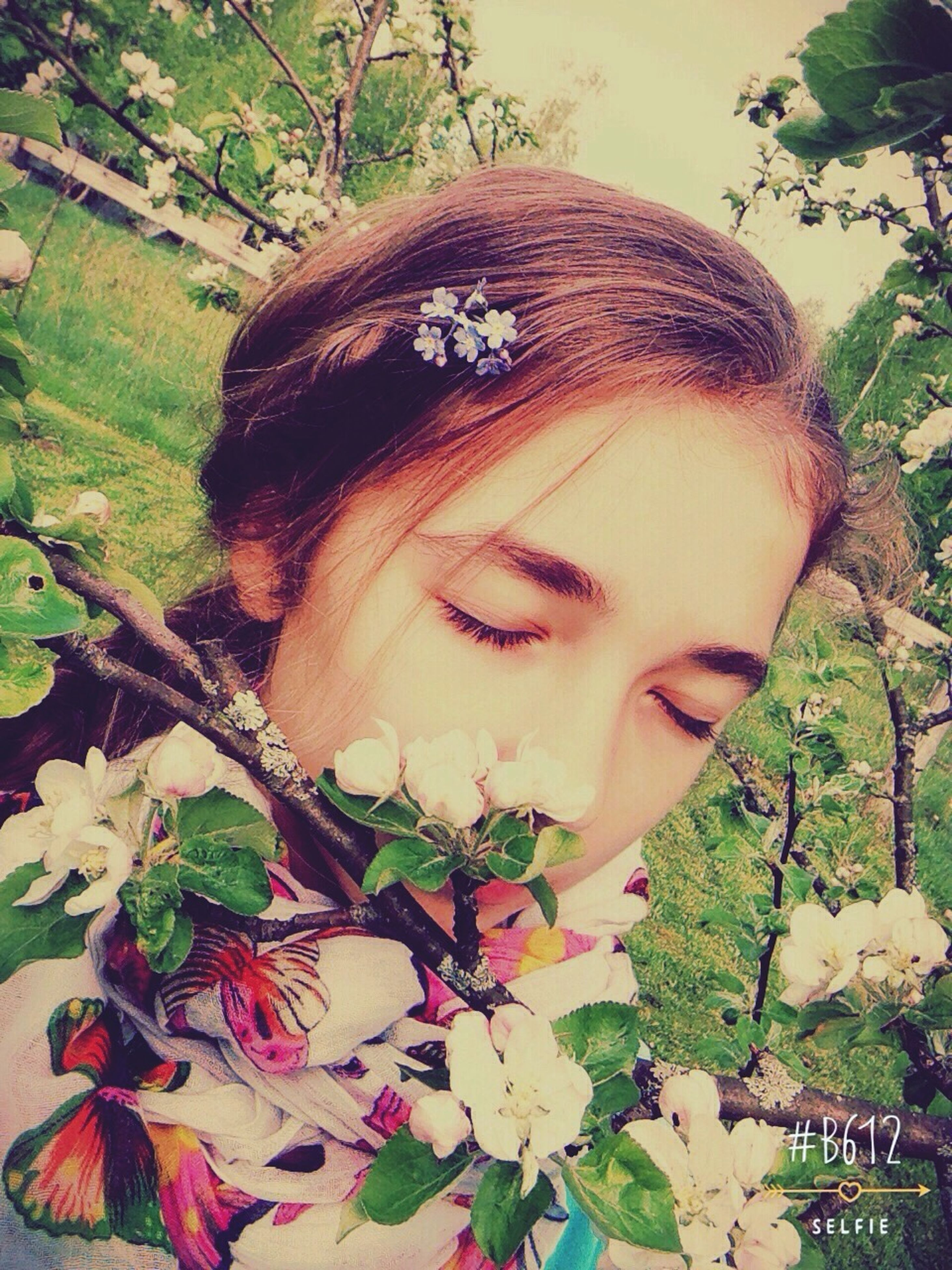 tree, leaf, close-up, growth, plant, nature, headshot, branch, human face, outdoors, day, lifestyles, young adult, focus on foreground, young women, flower, portrait, beauty in nature