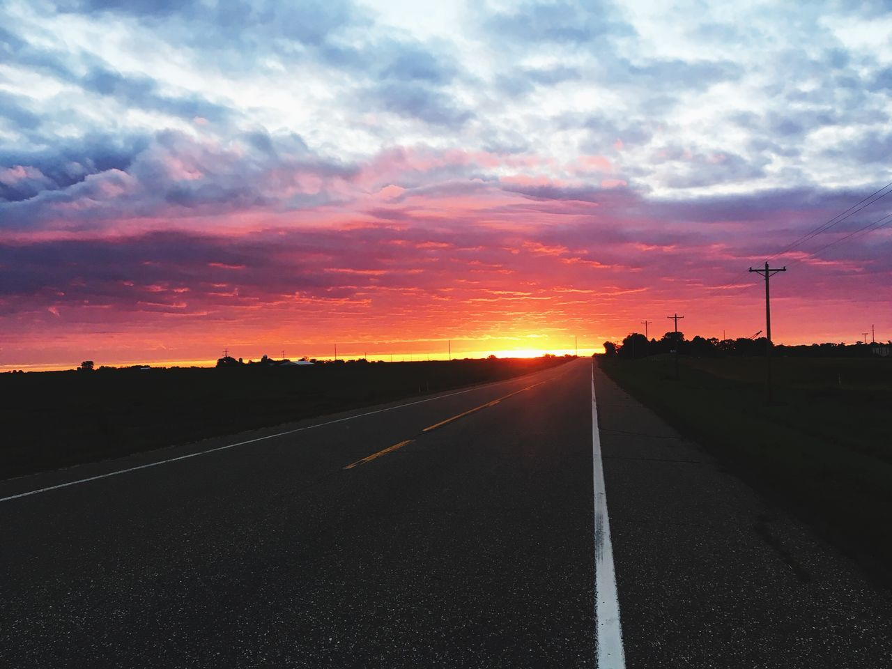 sunset, cloud - sky, road, sky, orange color, no people, the way forward, nature, transportation, outdoors, fuel and power generation, beauty in nature, scenics, silhouette, landscape, day, windmill