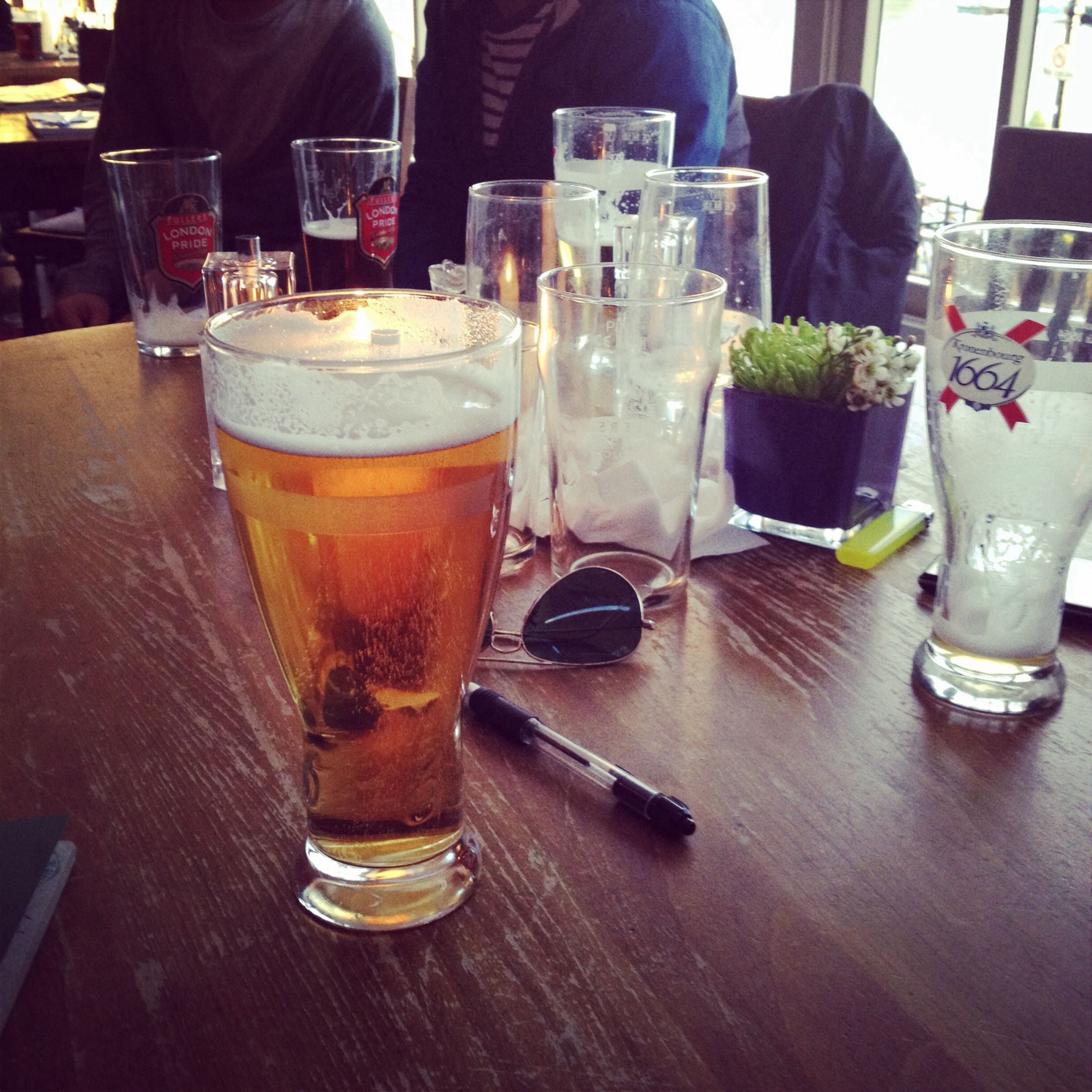 food and drink, drink, table, refreshment, drinking glass, indoors, freshness, still life, alcohol, restaurant, glass - material, close-up, glass, bottle, beer glass, healthy eating, food, juice, no people, transparent