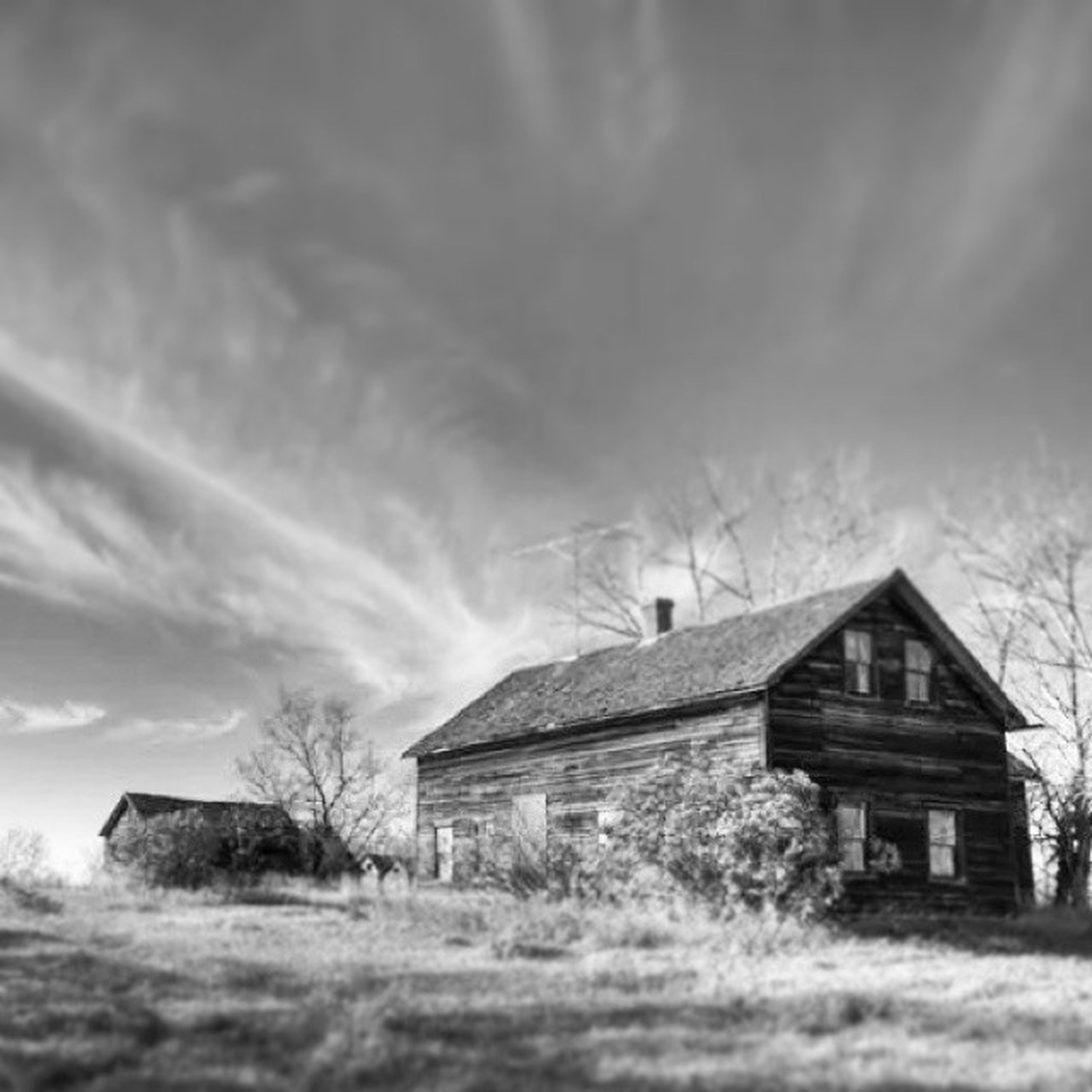 building exterior, architecture, built structure, house, sky, field, cloud - sky, tree, weather, landscape, grass, residential structure, cloudy, rural scene, nature, day, cloud, outdoors, residential building, transportation