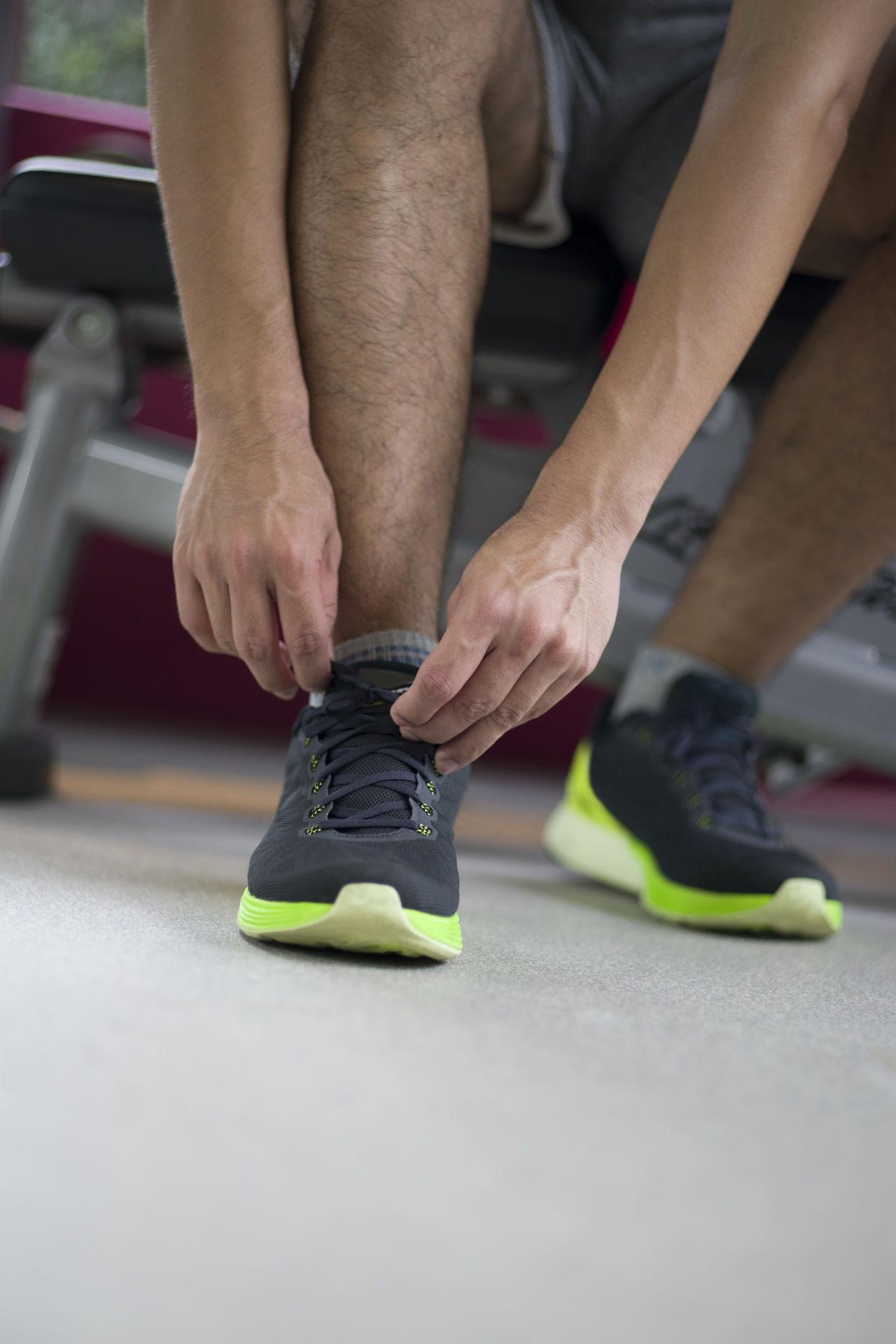 Lace up for the workout of your life. Athlete Day Exercise Fitness Footwear Green Gym Hand Healthy Healthy Lifestyle Human Leg Indoors  Legs Lifestyles Low Section Man Men Real People Shoes Sport Sports Sportswear Sportwear Tying Workout