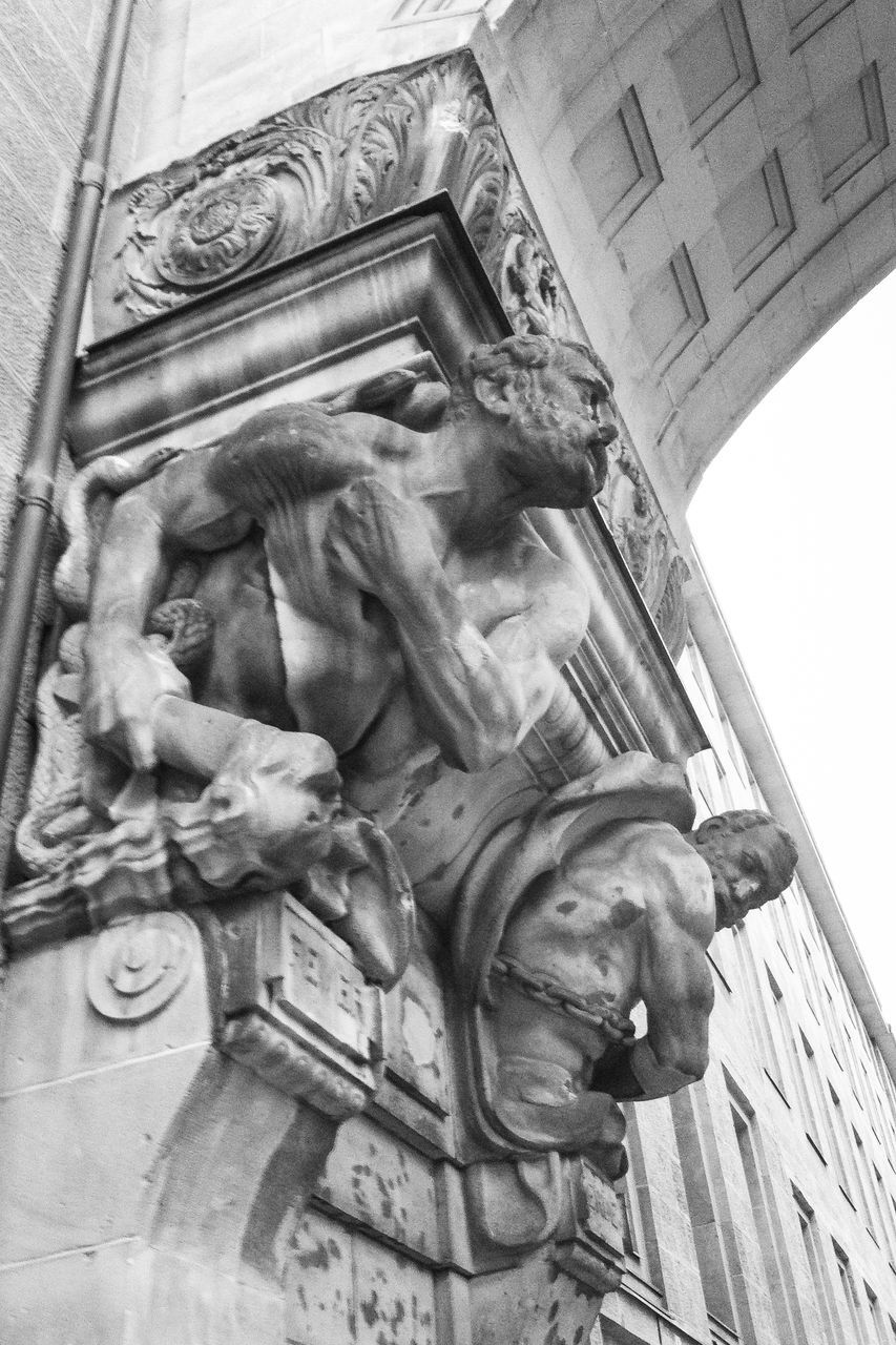 statue, low angle view, sculpture, architecture, built structure, history, outdoors, no people, building exterior, day, city, sky