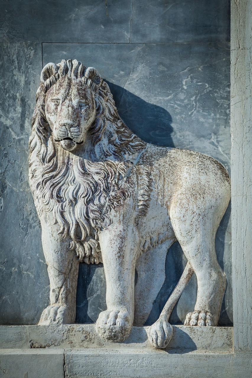 Lion Sculpture Against Wall