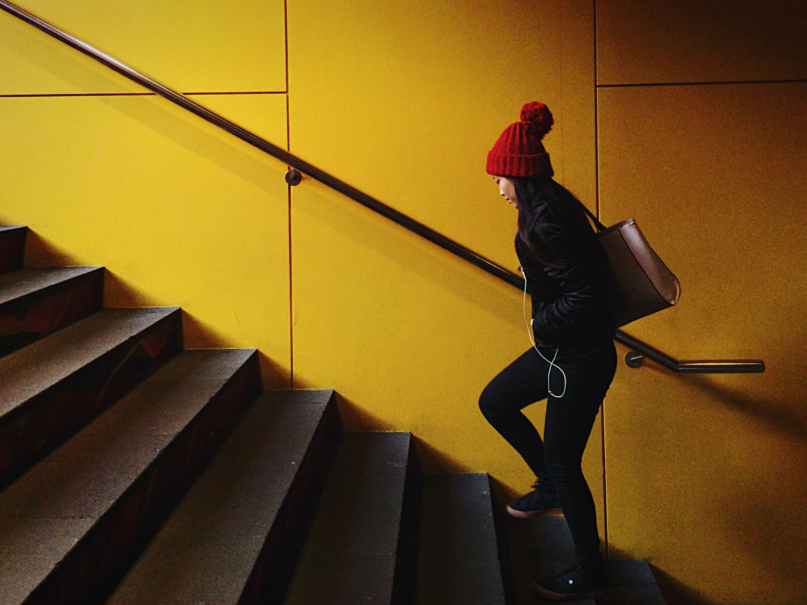 indoors, steps, lifestyles, wall - building feature, technology, staircase, steps and staircases, high angle view, yellow, musical instrument, music, built structure, leisure activity, standing, architecture, men, casual clothing, full length