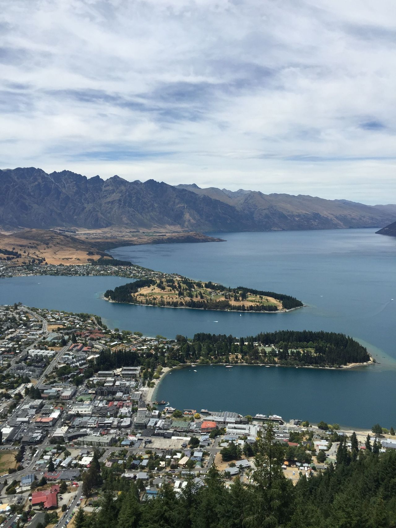 Blue Boat Boats Lake Lake Wakatipu Lakeshore Landscape Mountain Mountain Range Mountain View Mountains Nature Outdoors Outside Overlook Rock Rocks Scenic Sea The Remarkables Town Tranquil Trees Water Waterfront