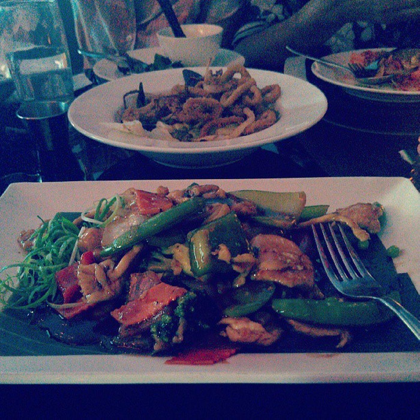 Enjoying Yummy Szechuan chicken, calamari, coconut shrimp and famous pad thai..
