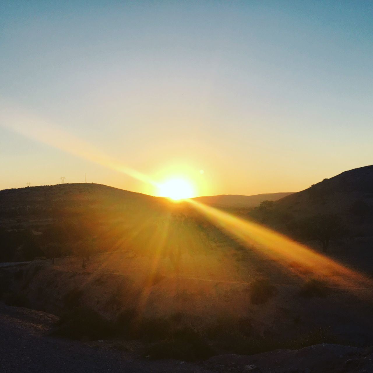 sun, sunbeam, sunset, sunlight, nature, silhouette, tranquility, tranquil scene, landscape, no people, scenics, beauty in nature, mountain, outdoors, sky, day