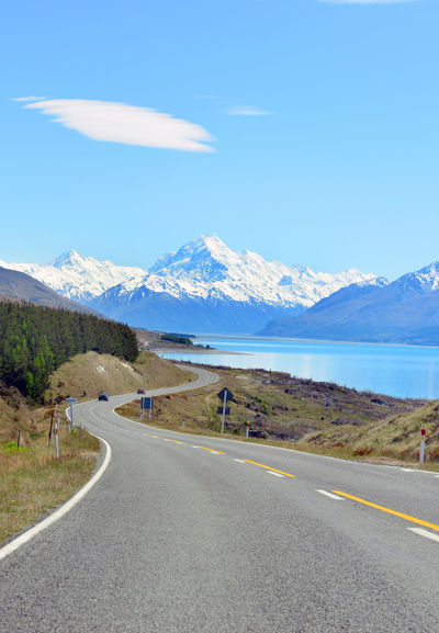 Mount cook viewpoint with the lake pukaki and the road leading to mount cook village in New Zealand. Aoraki Mount Cook National Park Beauty In Nature Day Lake Pukaki Landscape Mount Cook Mount Cook National Park Mountain Mountain Range Nature New Zealand No People Outdoors Road Scenics Sky Tranquil Scene Tranquility Viewpoint Winding Road