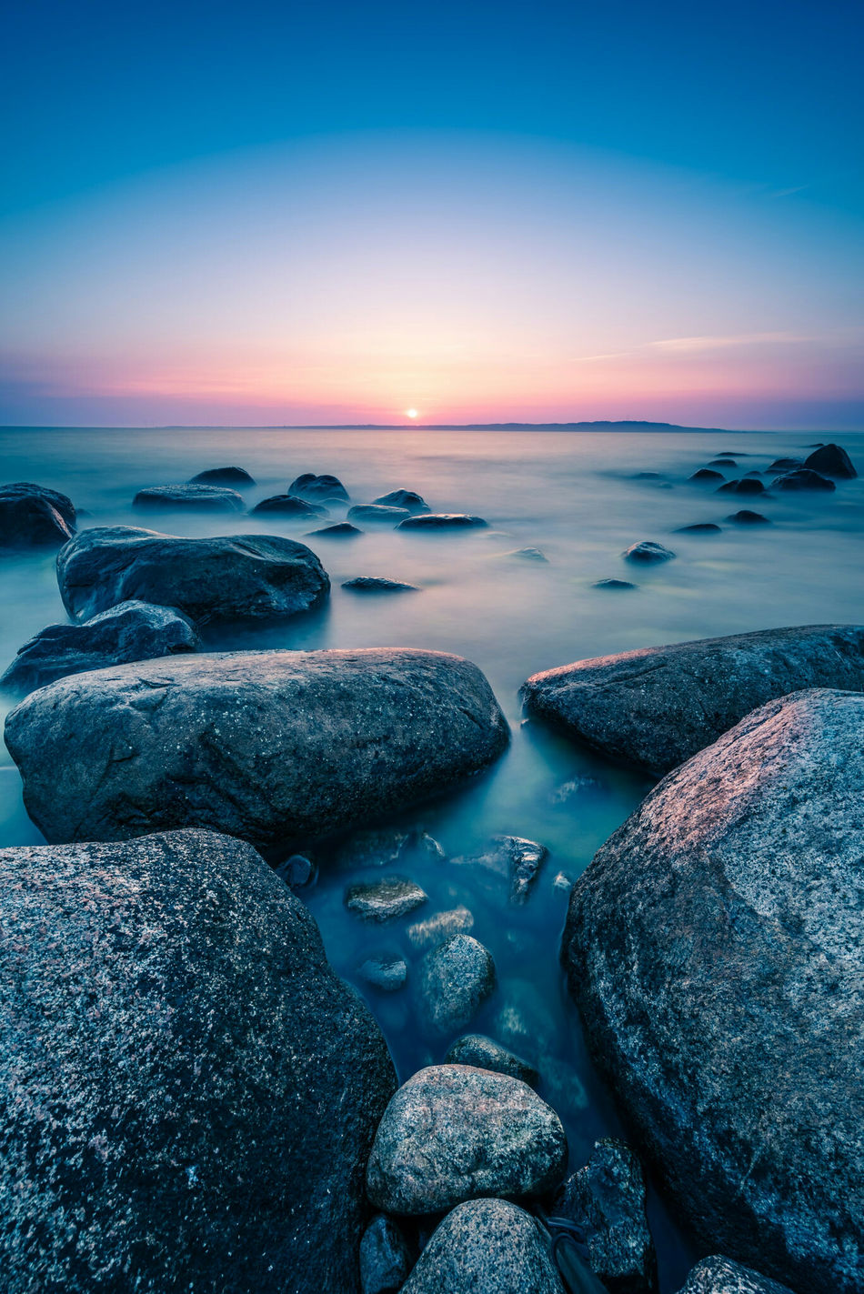 Protected pebbles. Water Sunset Tranquil Scene Scenics Sea Beauty In Nature Rock - Object Tranquility Idyllic Nature Blue Shore Non-urban Scene Sky Rock Formation Calm Outdoors Ocean No People Sweden Sweden Nature Hano