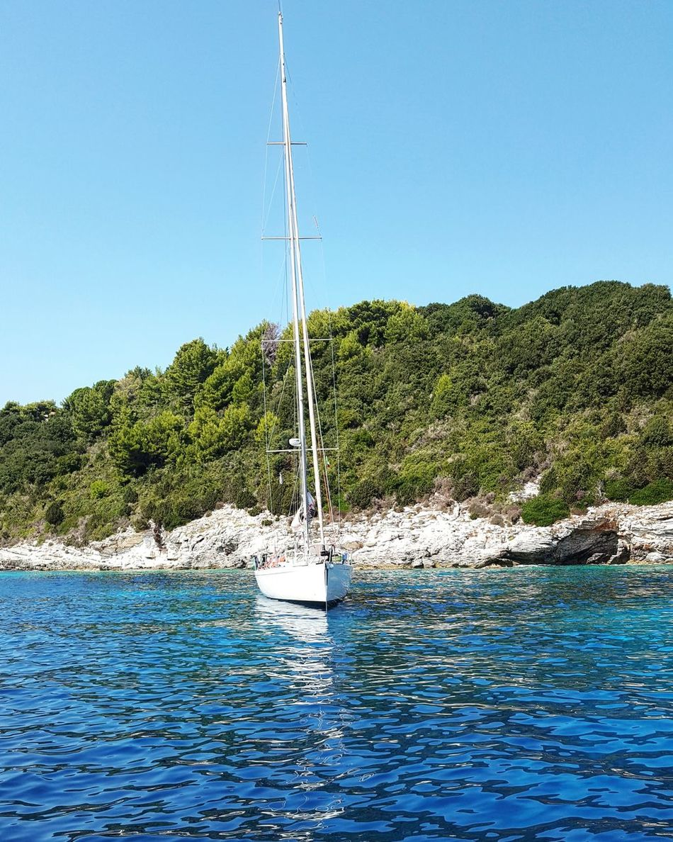 Lonely yacht Water Blue Clear Sky Sailboat Nature Day Non-urban Scene Beauty In Nature Outdoors Sky Vacations Tourism No People Colorful antipaxos WaterfrontSummer Beach Horizon Over Water Colour Of Life Greece Seascape Vacations Beauty In Nature Journey Nature