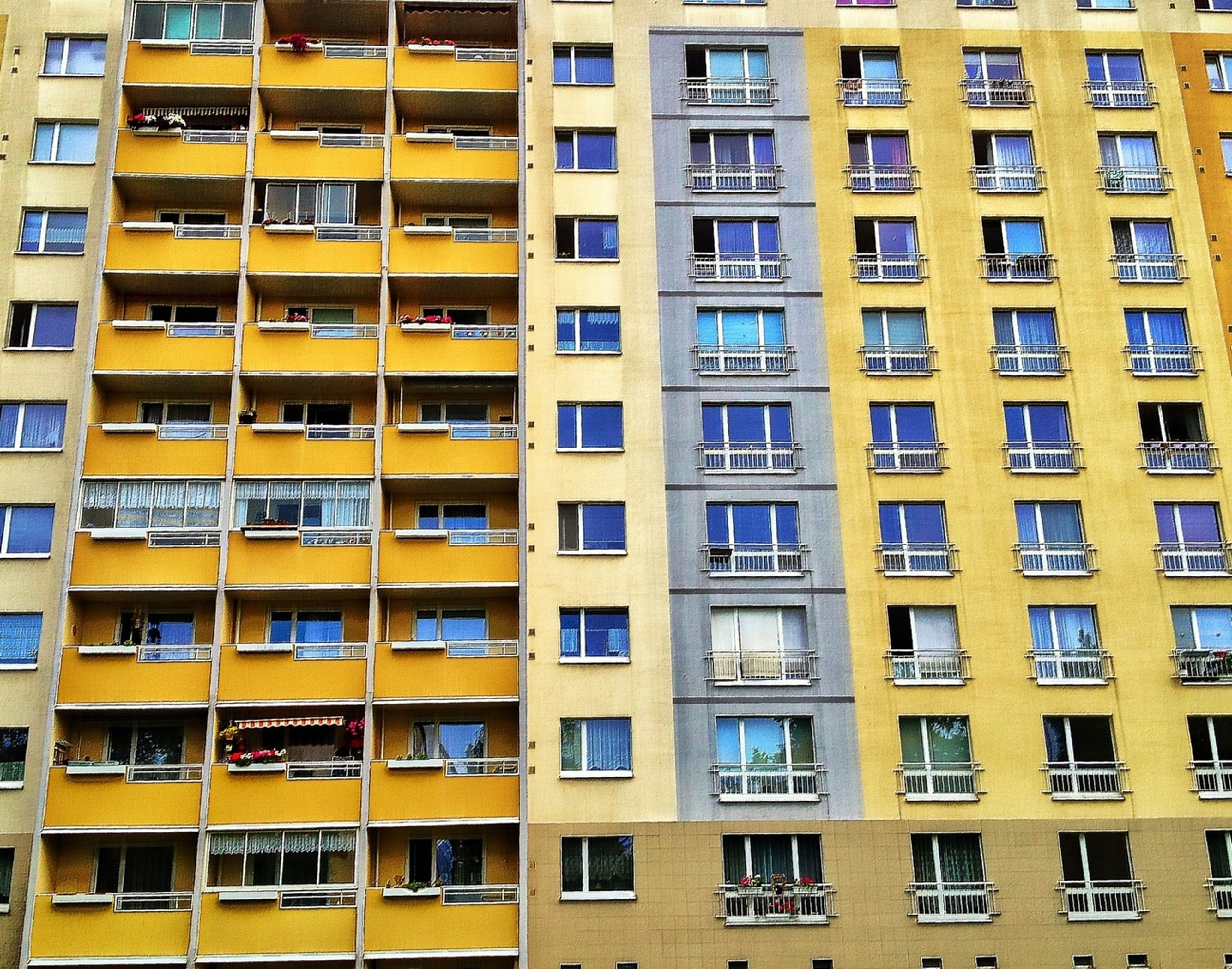building exterior, architecture, full frame, built structure, window, backgrounds, repetition, in a row, city, building, apartment, residential building, yellow, balcony, low angle view, residential structure, modern, side by side, glass - material, no people