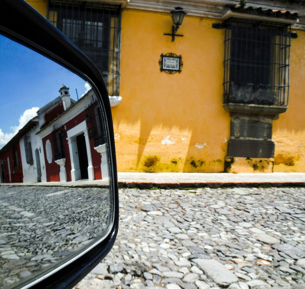 Portal. Different Perspective Mirror Reflection Cobblestone Streets Colonial Architecture Antigua, Guatemala Spanish Style Spanish Architecture Colonial Style Colonial Style Buildings Quaint  Street Photography New Perspective Perspective Photography Perspective Car Mirror Car Mirror View Cobblestone Cobblestones Cobbled Streets Cobbled Street Antigua Guatemala Optical Illusion Portal Better Look Twice The Drive
