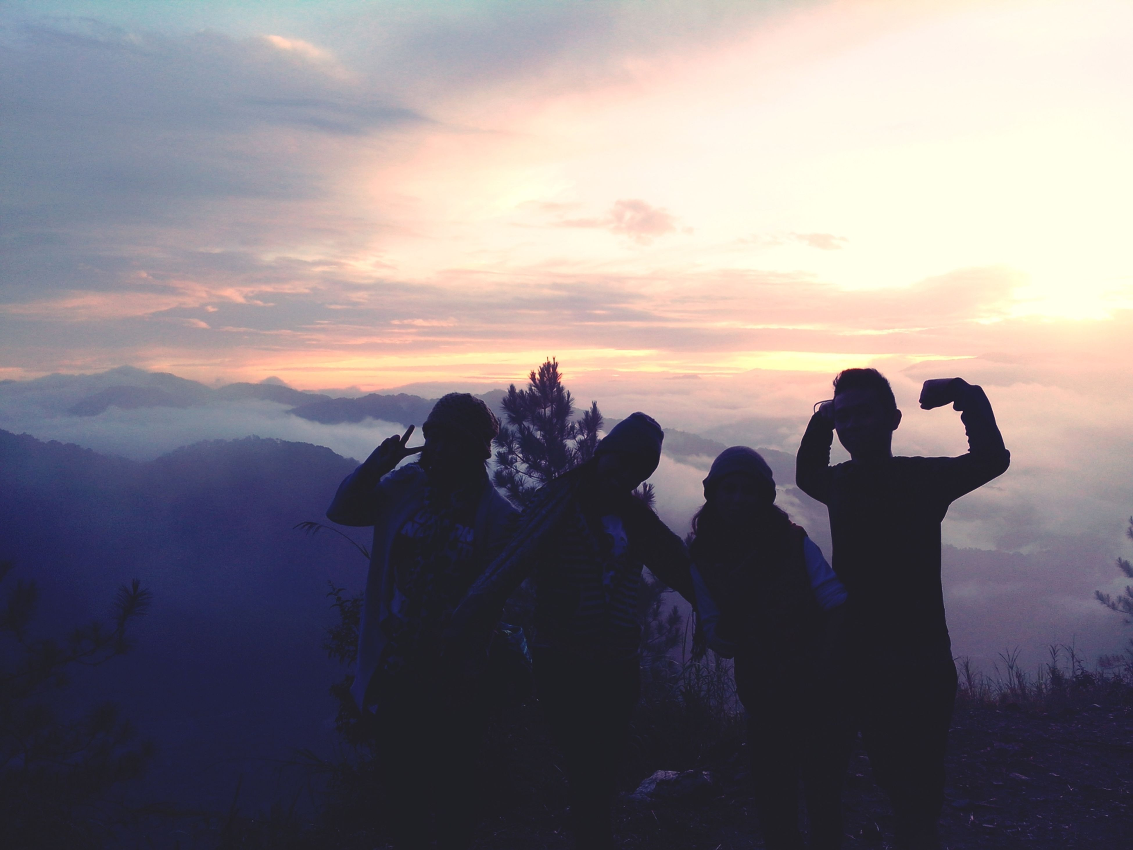 sunset, lifestyles, sky, leisure activity, silhouette, men, orange color, cloud - sky, standing, beauty in nature, person, scenics, nature, tranquility, tranquil scene, mountain, love
