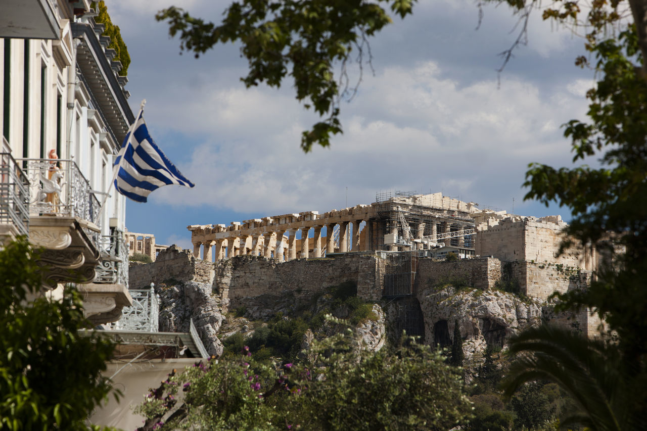 The Temple of Parthenon (Acropolis) as seen from Thission neighborhood Acropolis Architecture Balconies Building Exterior Built Structure City Day Doric Order Flag Green Color History Neoclassical Architecture No People Outdoors Parthenon Restoration Sky Travel Travel Destinations Tree Urban Vacations