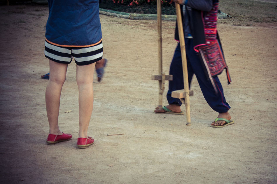 Unidentified Hill Tribe Children Walking On Wooden Stilts In Miracle Tea Festival, Sakura Blossom, Several Tribe Culture At Doi Mae Salong Mae Chan Chiang Rai Province Thailand. December 28, 2015: Miracle Tea Festival 20 th. ASIA Attraction Casual Clothing Children Clothing Culture Exotic Eye4photography  EyeEm Best Shots Festival Hilltribe Leisure Activity Lifestyles People Photography Several Standing Streetphotography Everything In Its Place Togetherness Travel Photography Tribe Unidentified Walking Wooden Stilts
