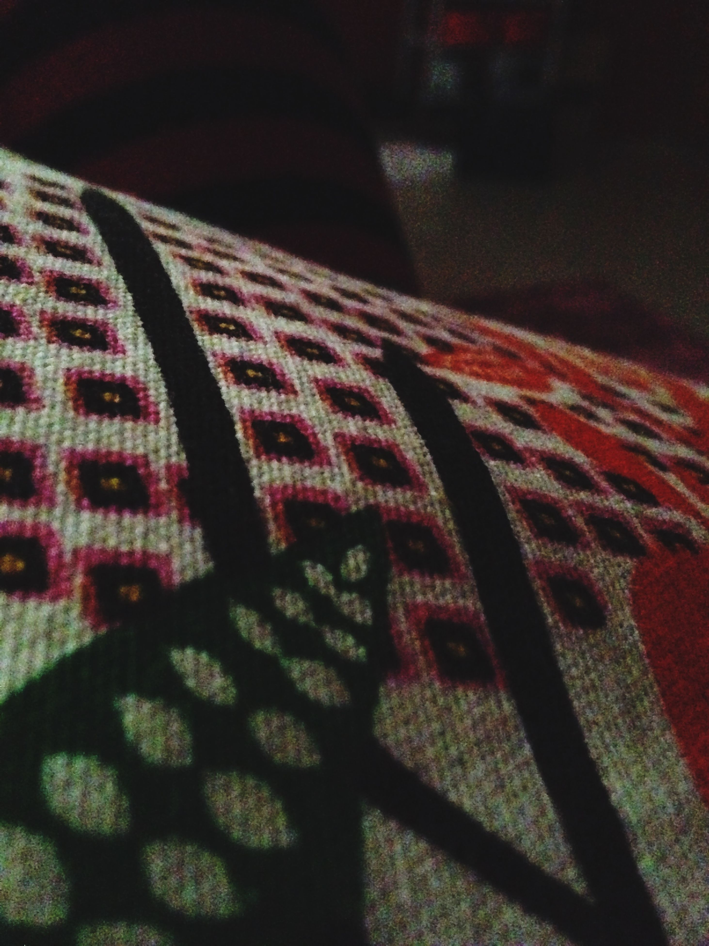 indoors, red, close-up, textile, fabric, pattern, shadow, high angle view, still life, striped, design, no people, sunlight, absence, paper, home interior, black color, bed, detail, textured
