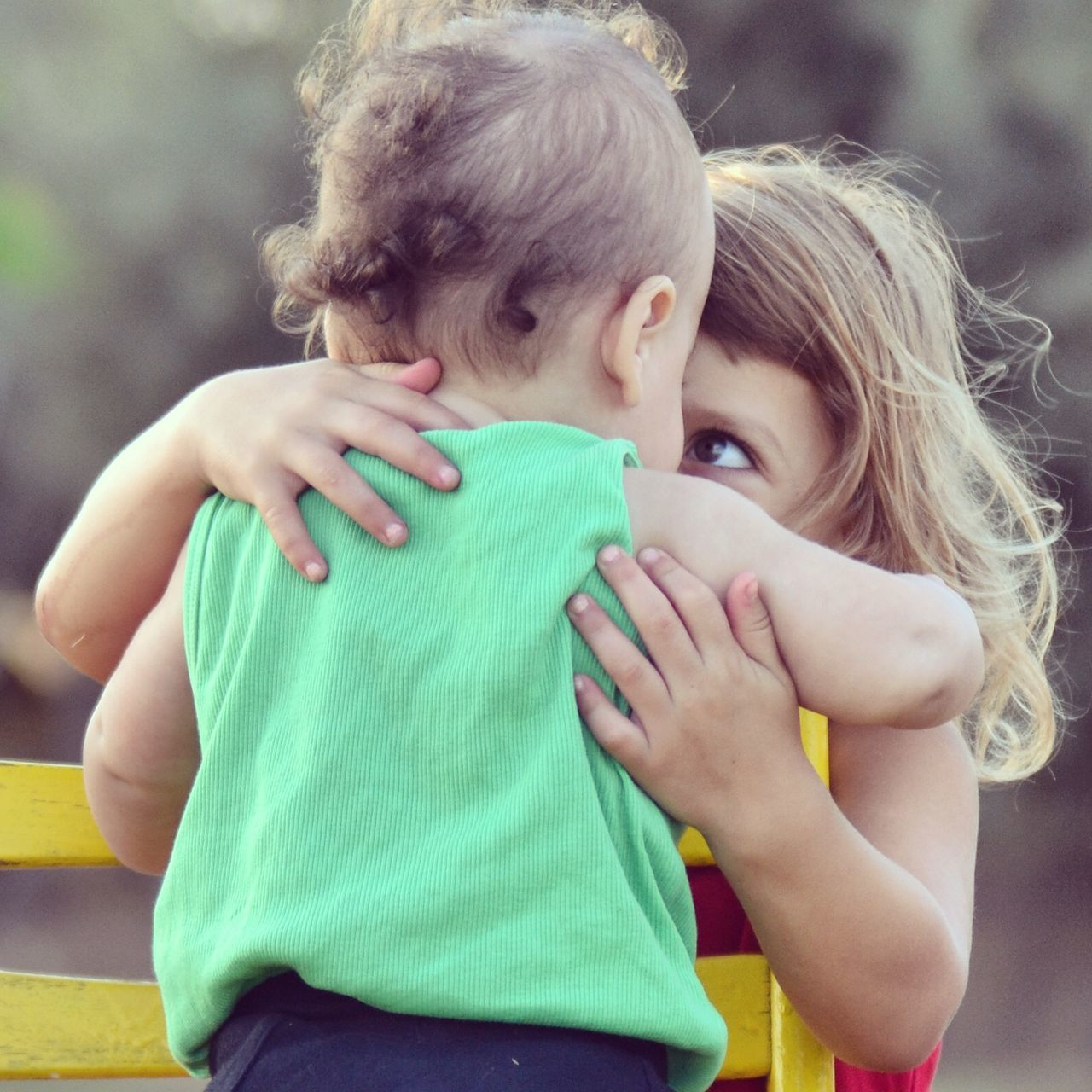 childhood, togetherness, love, real people, bonding, innocence, family with one child, embracing, casual clothing, lifestyles, family, girls, day, cute, leisure activity, hugging, looking at camera, elementary age, boys, outdoors, care, young women, portrait, close-up, blond hair, tree, young adult, people
