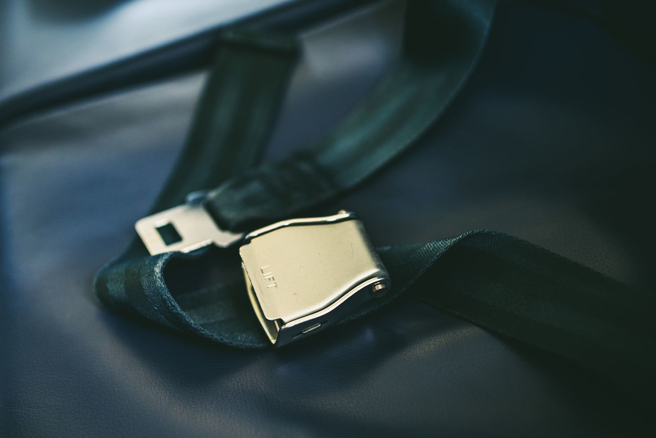 Close-Up Of Seat Belt On Seat In Airplane