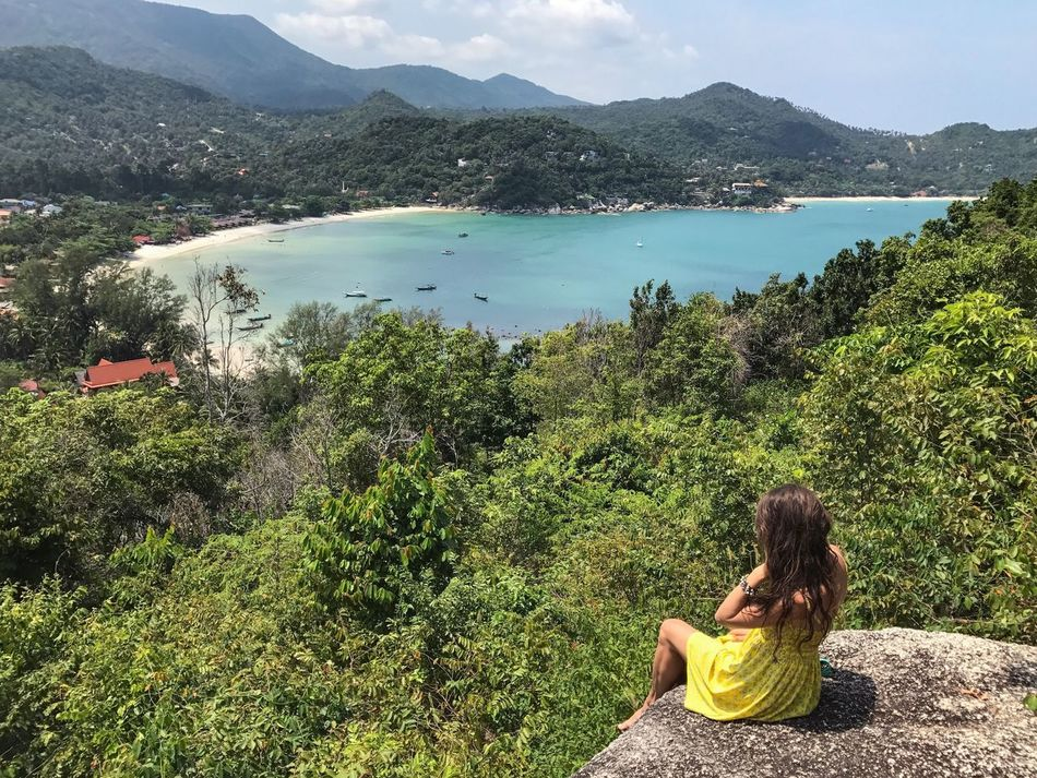 One Person Young Adult Nature Mountain Tree Sitting Beauty In Nature Outdoors Water Adults Only Only Women Yellow Dress One Young Woman Only Idyllic Scenery Thailand Ko Phangan Enjoying The View Sea And Sky View From Above Travel Destinations Tourism Leisure Activity Lifestyles Sky Long Hair