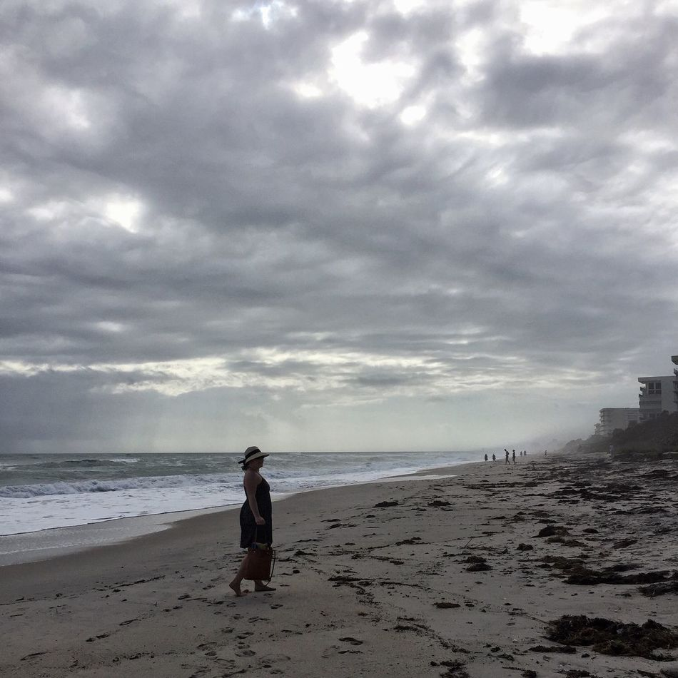 Misty grey morning on the beach Melbourne Beach, FL Young Woman Cloud - Sky Beach One Person Shore Real People Leisure Activity Cloudy Morning Young Adult Grey Day Morning Mist Morning Mist In Landscape