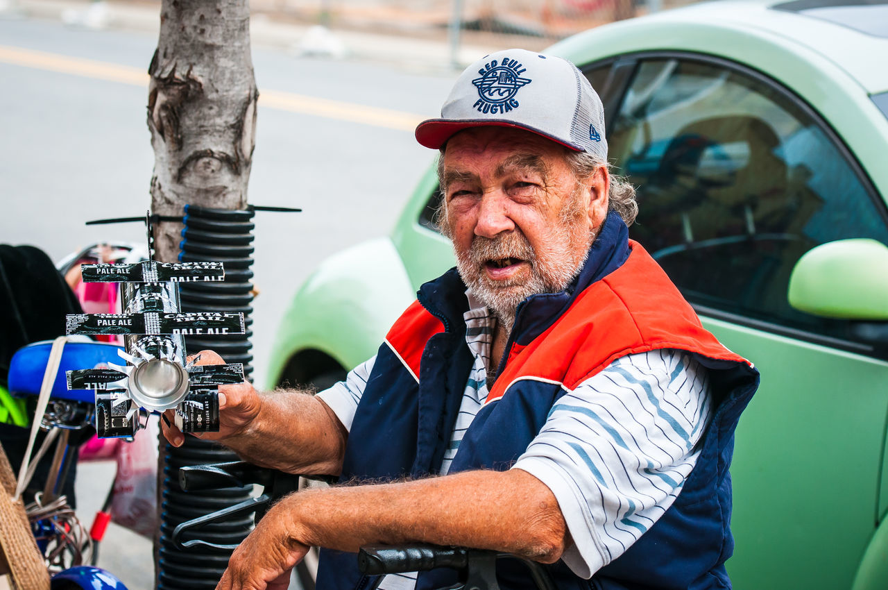 Richmond, VA USA Artist Artist Colorful Character Disabled Veteran Front View Gray Beard Hanging Out Lifestyles Looking At Camera Person Real People Sitting Tin Can Artist Tin Can Man Tin Can Sculptor War Veteran Weary