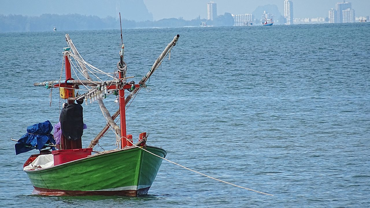 Thai Fishing Boat Nautical Vessel Water Transportation Boat Mode Of Transport Men Leisure Activity Lifestyles Journey Travel Waterfront Sailing Rippled Sea Nature Scenics Tourist Tranquility Tranquil Scene Day Huahin Thailand HuaHin Sea@Thailand Hua Hin , Thailand  Fishing Boat Fisherboat