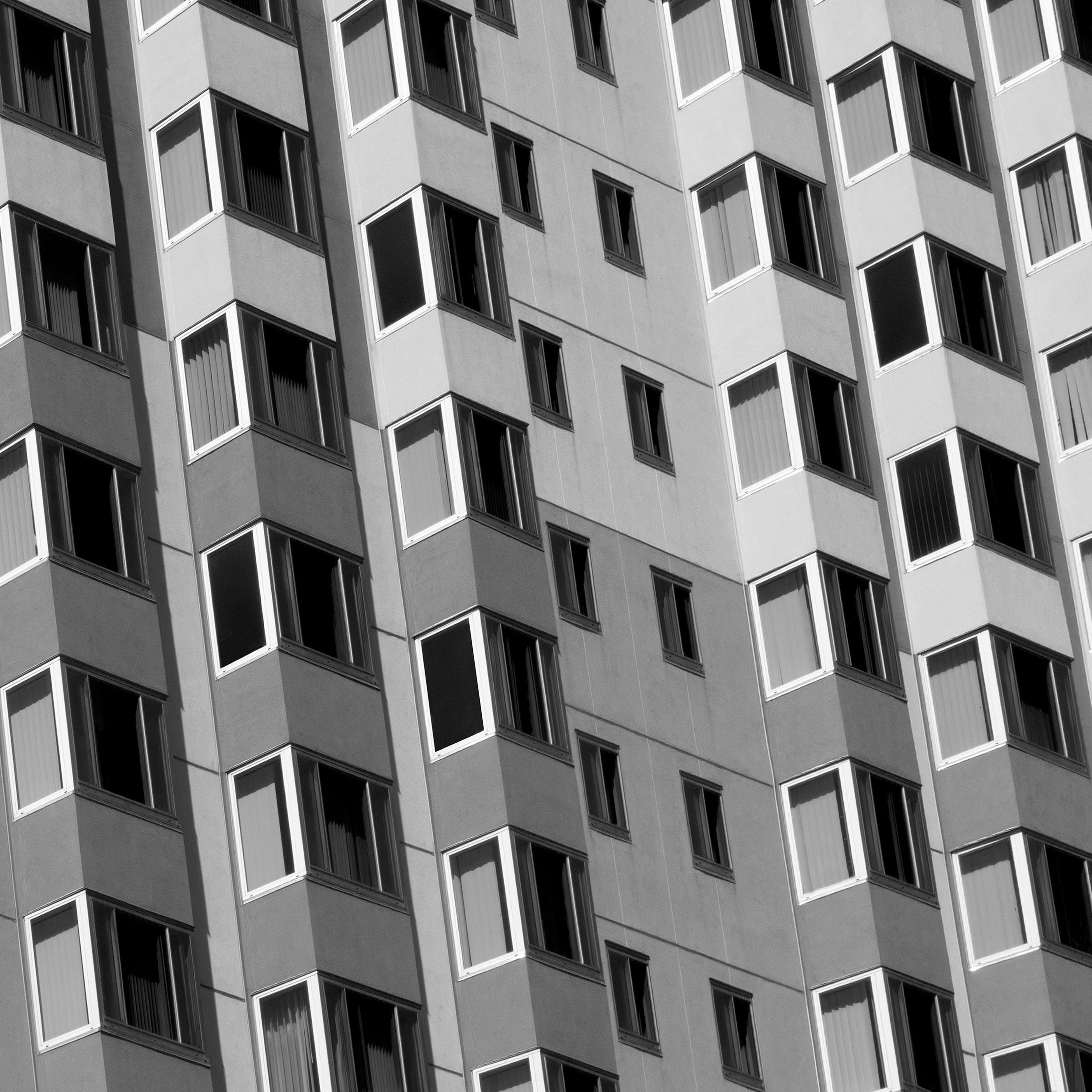 building exterior, architecture, built structure, window, full frame, backgrounds, apartment, city, repetition, residential building, residential structure, building, in a row, low angle view, balcony, day, no people, outdoors, pattern, modern