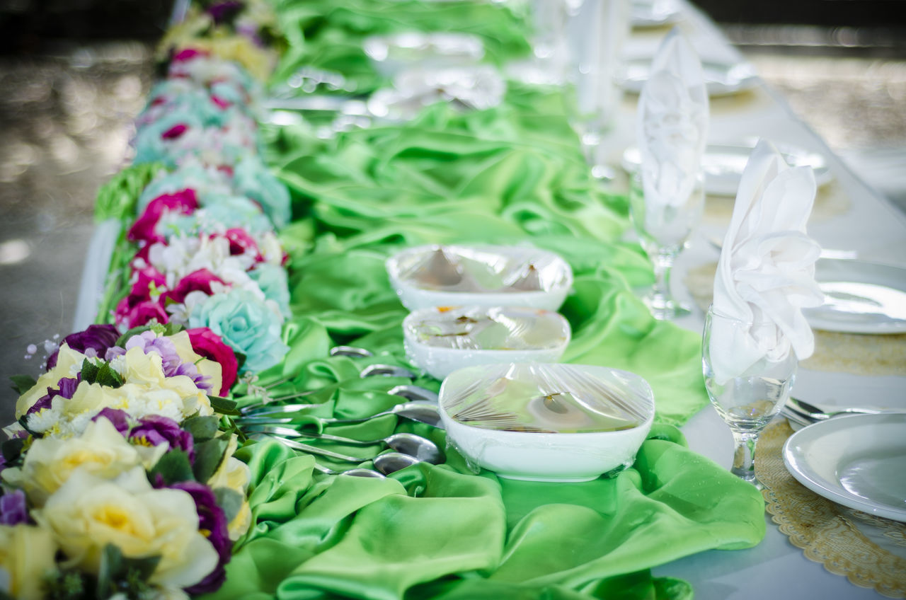 plate, food and drink, no people, food, high angle view, indoors, table, green color, drinking glass, large group of objects, sweet food, freshness, place setting, close-up, day, ready-to-eat