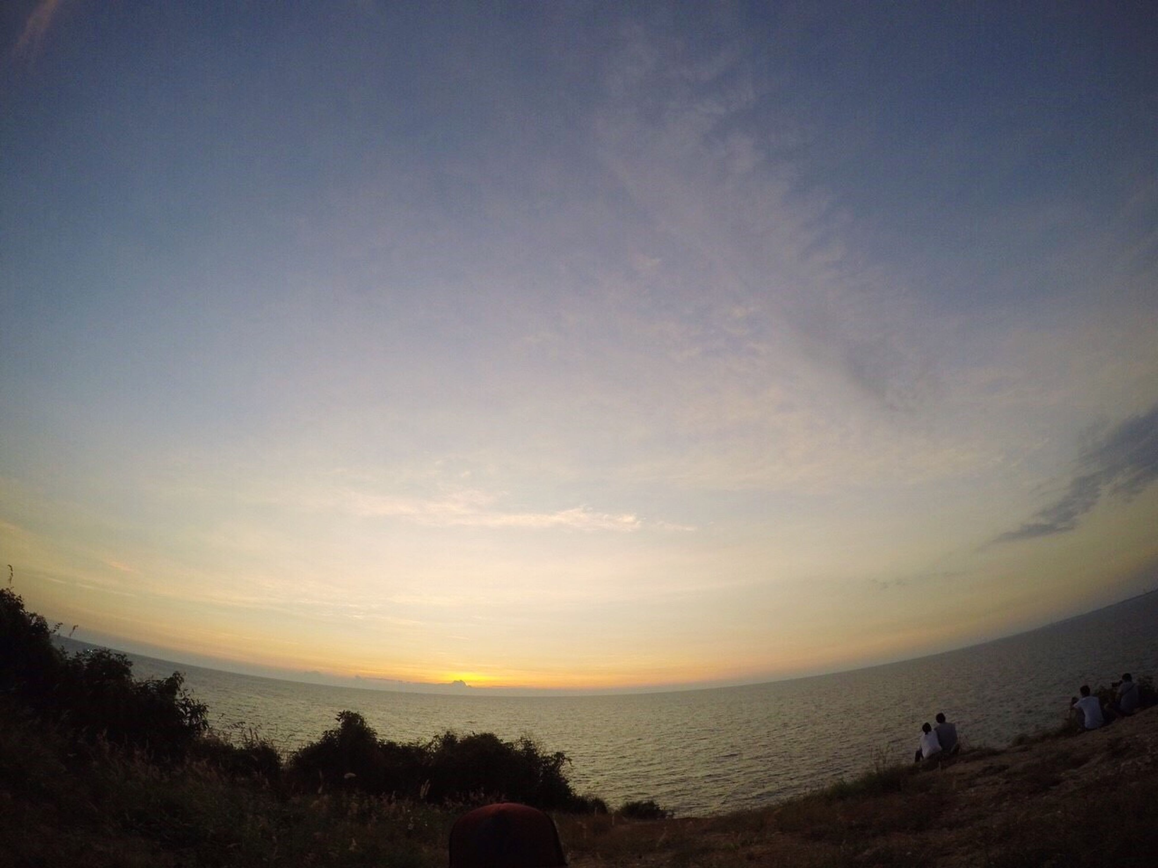 sea, horizon over water, beach, water, scenics, sky, tranquil scene, beauty in nature, tranquility, sunset, shore, nature, idyllic, silhouette, vacations, leisure activity, cloud - sky, lifestyles, outdoors