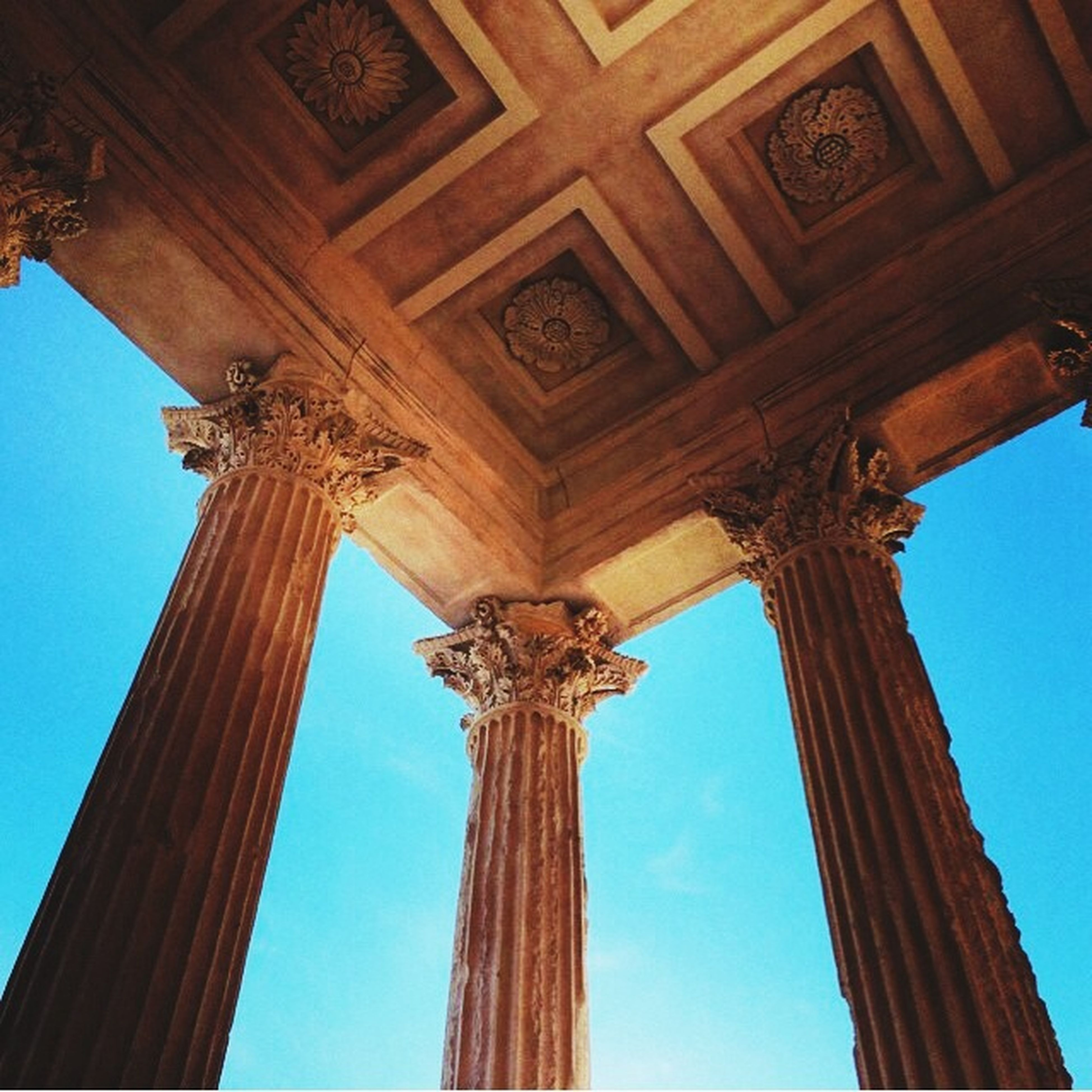 low angle view, architecture, built structure, architectural column, clear sky, column, history, blue, famous place, old, travel destinations, day, the past, architectural feature, international landmark, no people, old ruin, tourism, sky, travel
