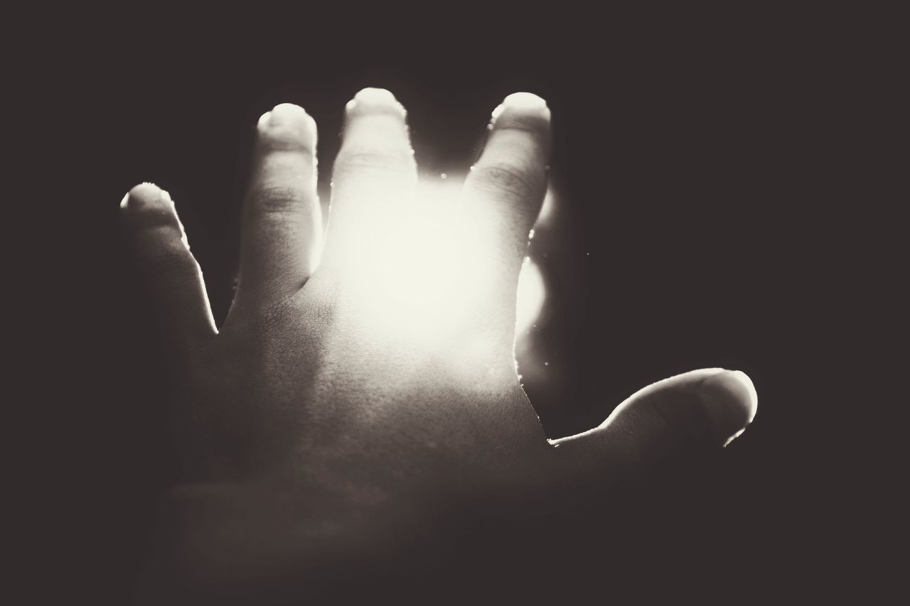 human body part, one person, human hand, black background, close-up, studio shot, adult, day, people