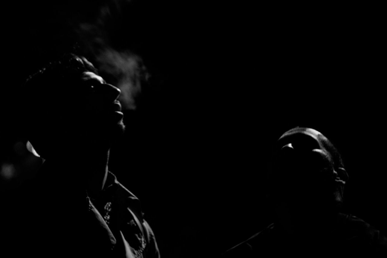 ~ Essence of the Night (Breath) ~The Portraitist - 2017 EyeEm Awards People Two People Smoking - Activity Adults Only Social Issues Headshot Lifestyles Night Human Body Part Real People Black Background Close-up Young Adult Adult Men Monochrome Black & White Light And Shadow Live For The Story Getting Inspired Shadow Human Face Inspiring Canonphotography