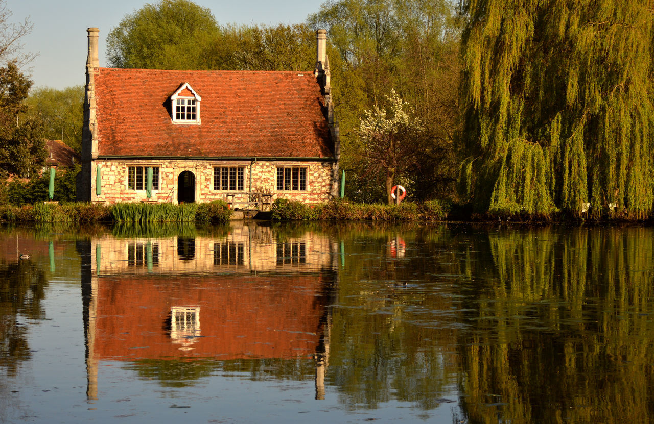 architecture, building exterior, built structure, reflection, house, no people, water, tree, outdoors, day, residential building, lake, grass, nature