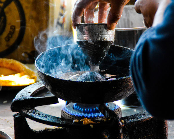 Local Food Local Food Culture Preparation  Heat - Temperature Stove Food And Drink Cooking Pan Flame Preparing Food Food Burner - Stove Top Burning Indoors  Smoke - Physical Structure Freshness Close-up Day People Adults Only One Person Adult Travel Photography Nepal Travel