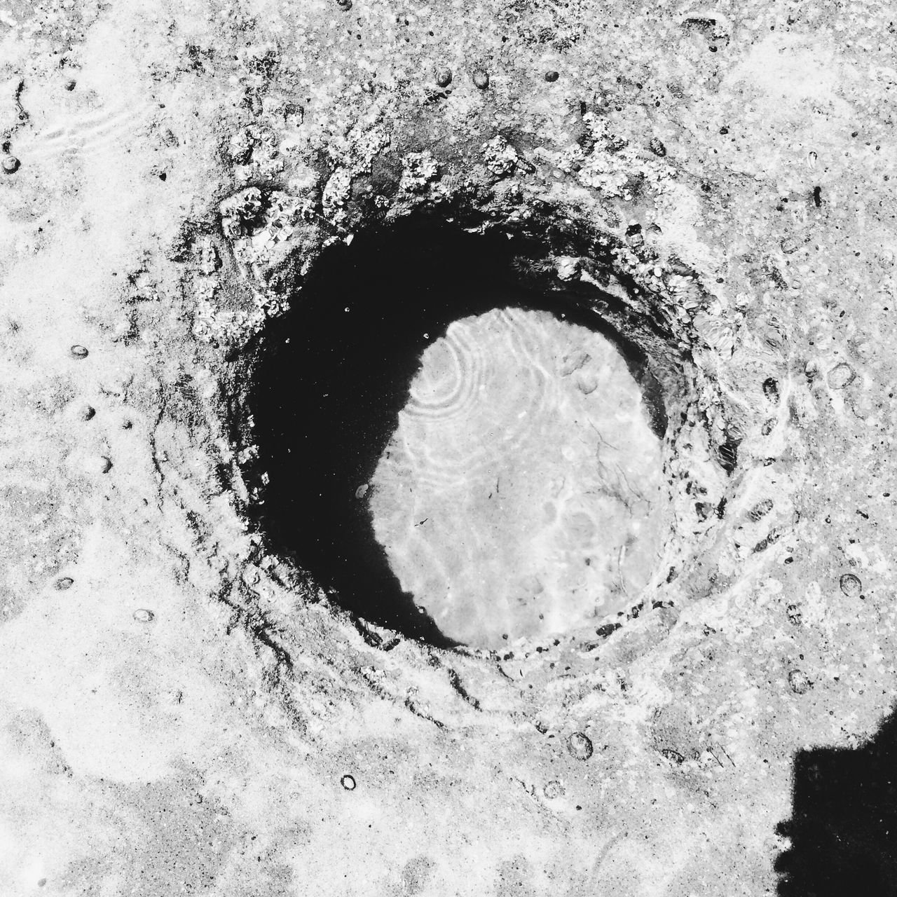 High Angle View Of Hole In Beach