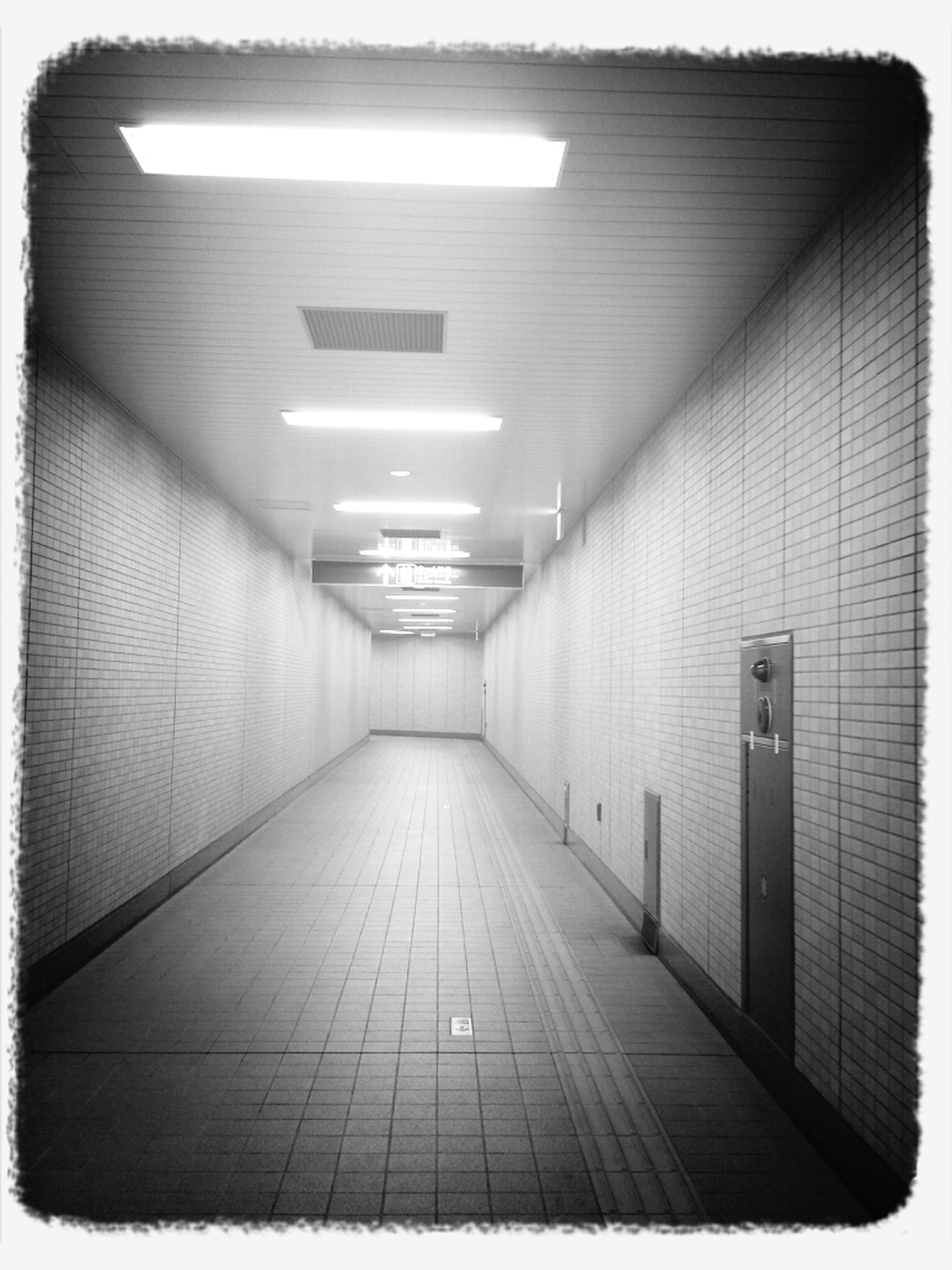 indoors, transfer print, the way forward, illuminated, architecture, auto post production filter, built structure, diminishing perspective, lighting equipment, empty, wall - building feature, absence, ceiling, corridor, tunnel, vanishing point, transportation, no people, wall, building