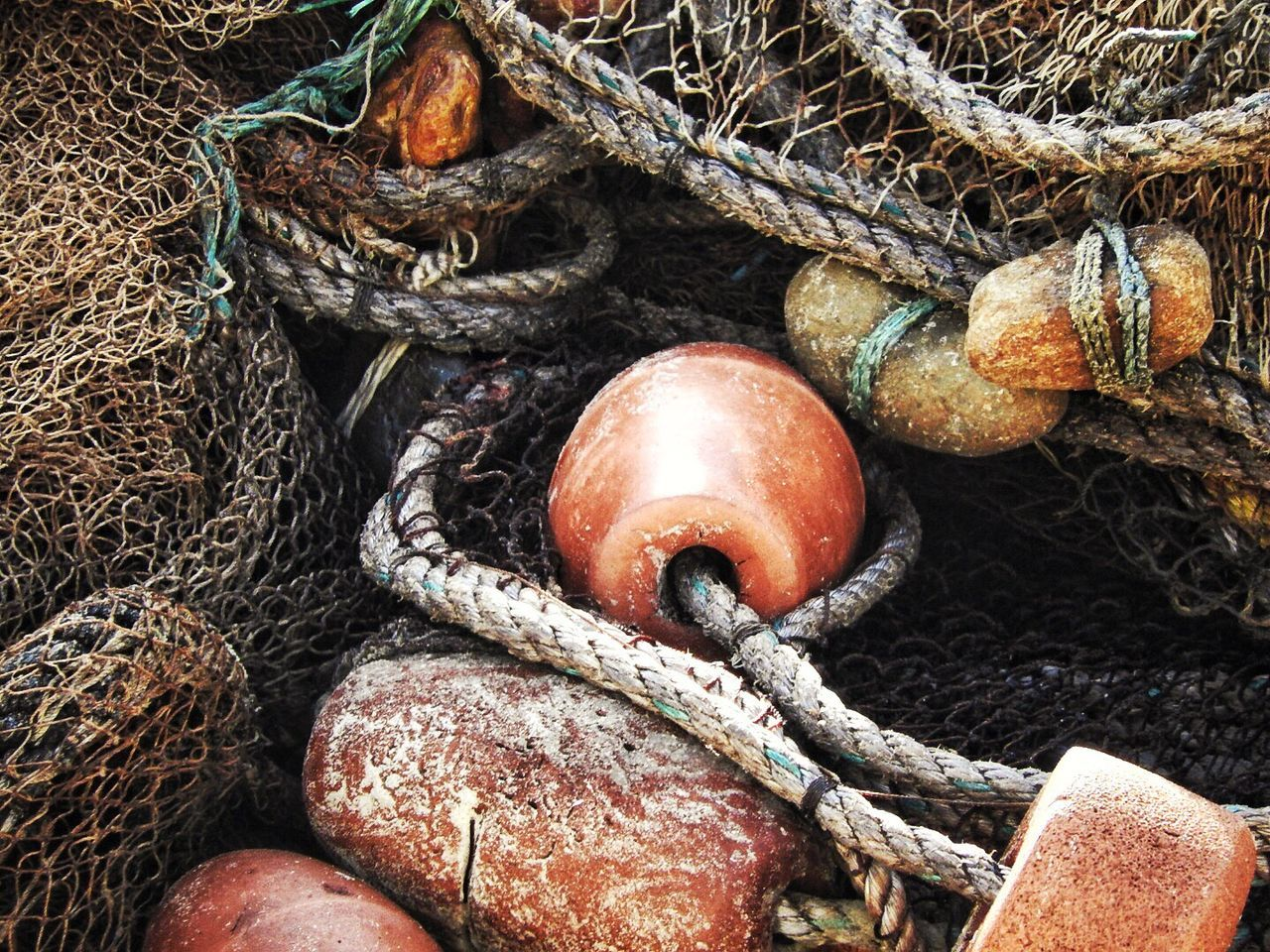 Fishing nets and weights Goa Fishing Net Weights Rope Sea Fishing Stones Net Goa India