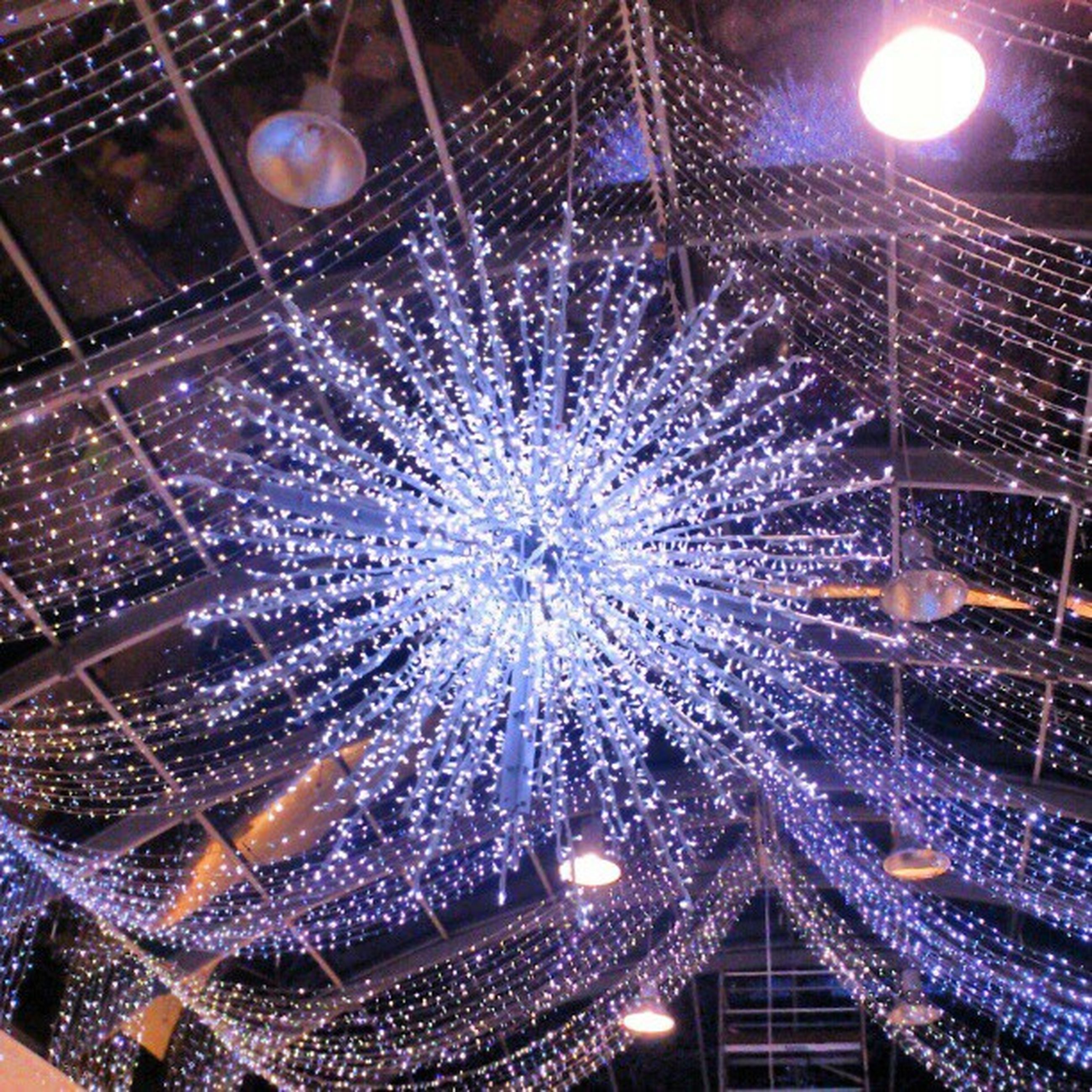 illuminated, night, lighting equipment, low angle view, decoration, celebration, built structure, hanging, architecture, indoors, glowing, christmas decoration, ceiling, modern, christmas lights, christmas tree, arts culture and entertainment, christmas, building exterior, electric light