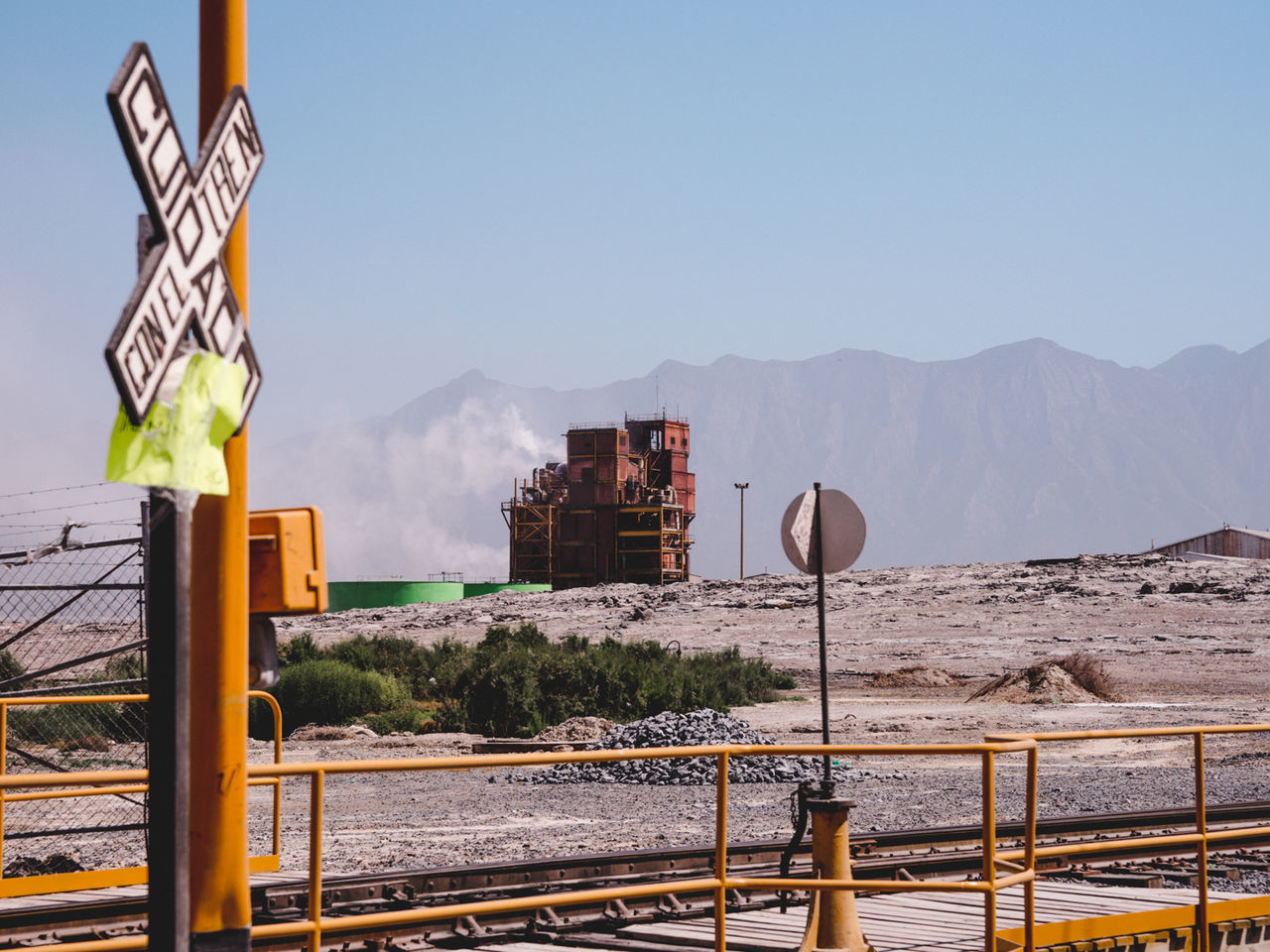 Beauty In Nature Blue Culture Day Factory Factory Building Factory Chimney Industrial Industrial Landscapes Mexico Monterrey Mountain Mountain Range Mountains Nature No People Outdoors Pole Scenics Sky Train Train Tracks Tranquil Scene Tranquility Travel Destinations