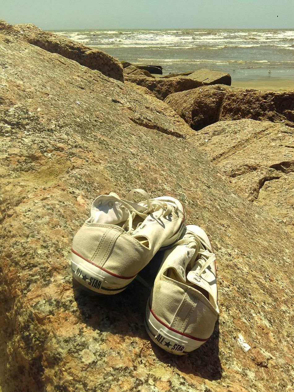 Two Is Better Than One Lost Shoes Big Feet Snickers Tennis Shoes Rocks And Water Alantic Ocean Waves, Ocean, Nature Outdoors Daytime