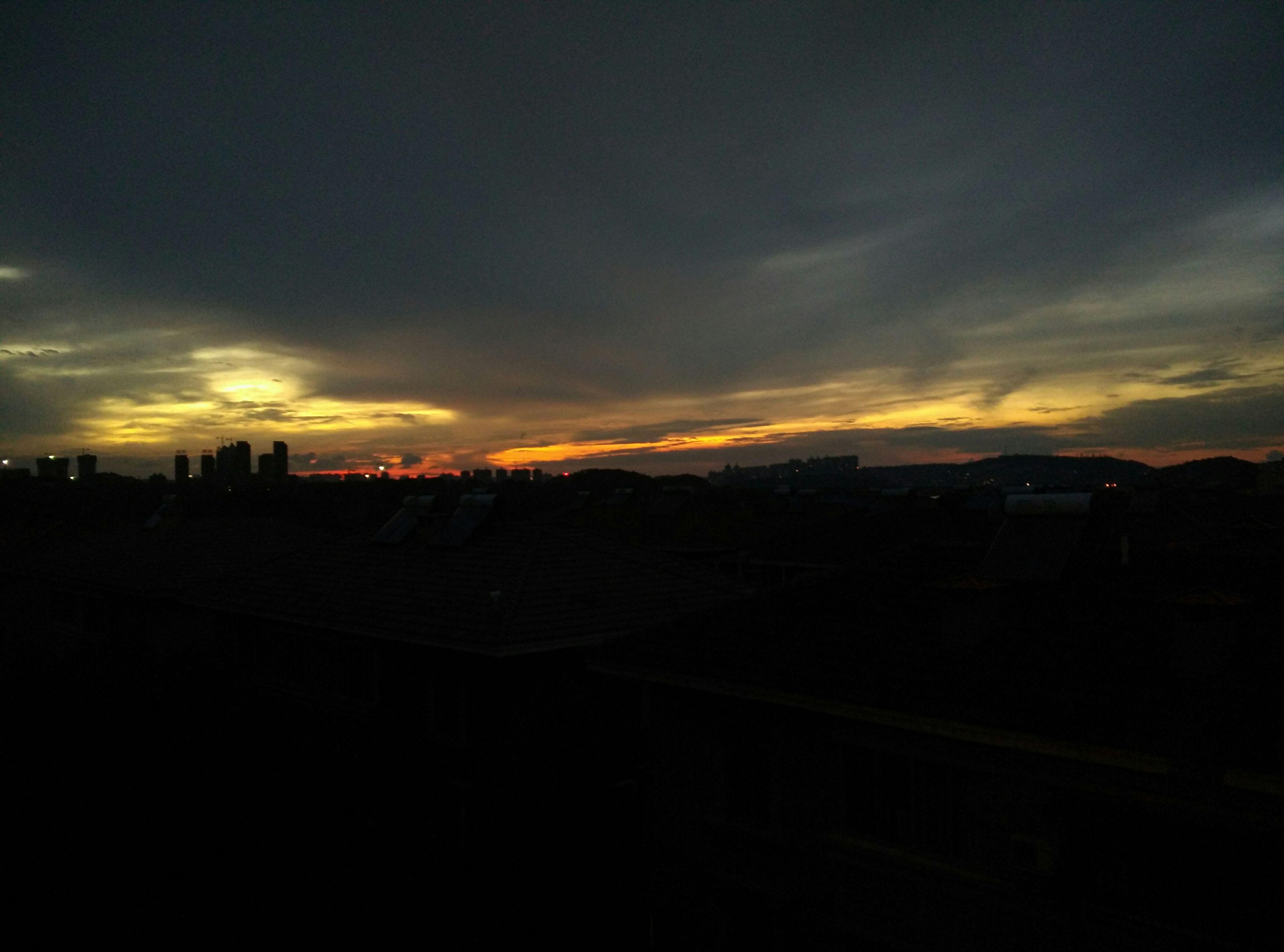 sunset, silhouette, building exterior, sky, built structure, architecture, scenics, cloud - sky, beauty in nature, orange color, dark, tranquil scene, dusk, tranquility, house, nature, landscape, cloud, residential structure, city
