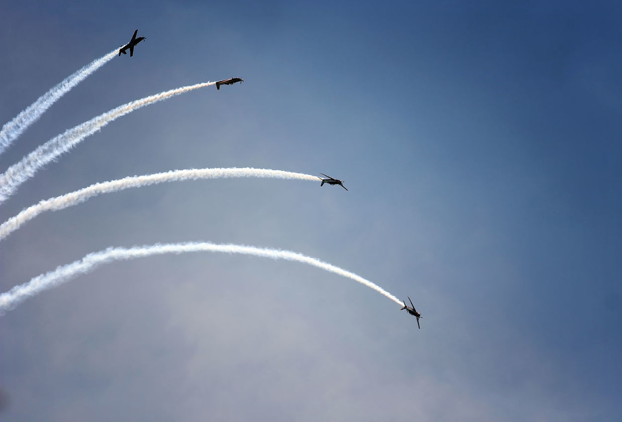 Formation Flying TNIAU Indonesianairforce Jupiteraerobaticteam Indonesiamilitary Teamwork Airshow Vapor Trail Flying Airplane Low Angle View Acrobatic Activity Teamwork Speed Smoke - Physical Structure Transportation Air Vehicle Aerobatics Formation Flying Air Force Outdoors Day No People Military Airplane Stunt