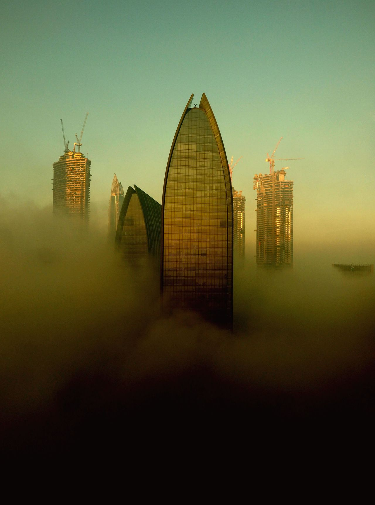 Foggy morning in Dubai Architecture Boulevard Plaza Tower 1 Built Structure Cityscape Dubai Fog Foggy Morning Golden Hour Metropolis Middle East Rising High  Skyscrapers Skyscrapers In The Clouds Skysrapers Sunrise United Arab Emirates Weather Photography My Year My View