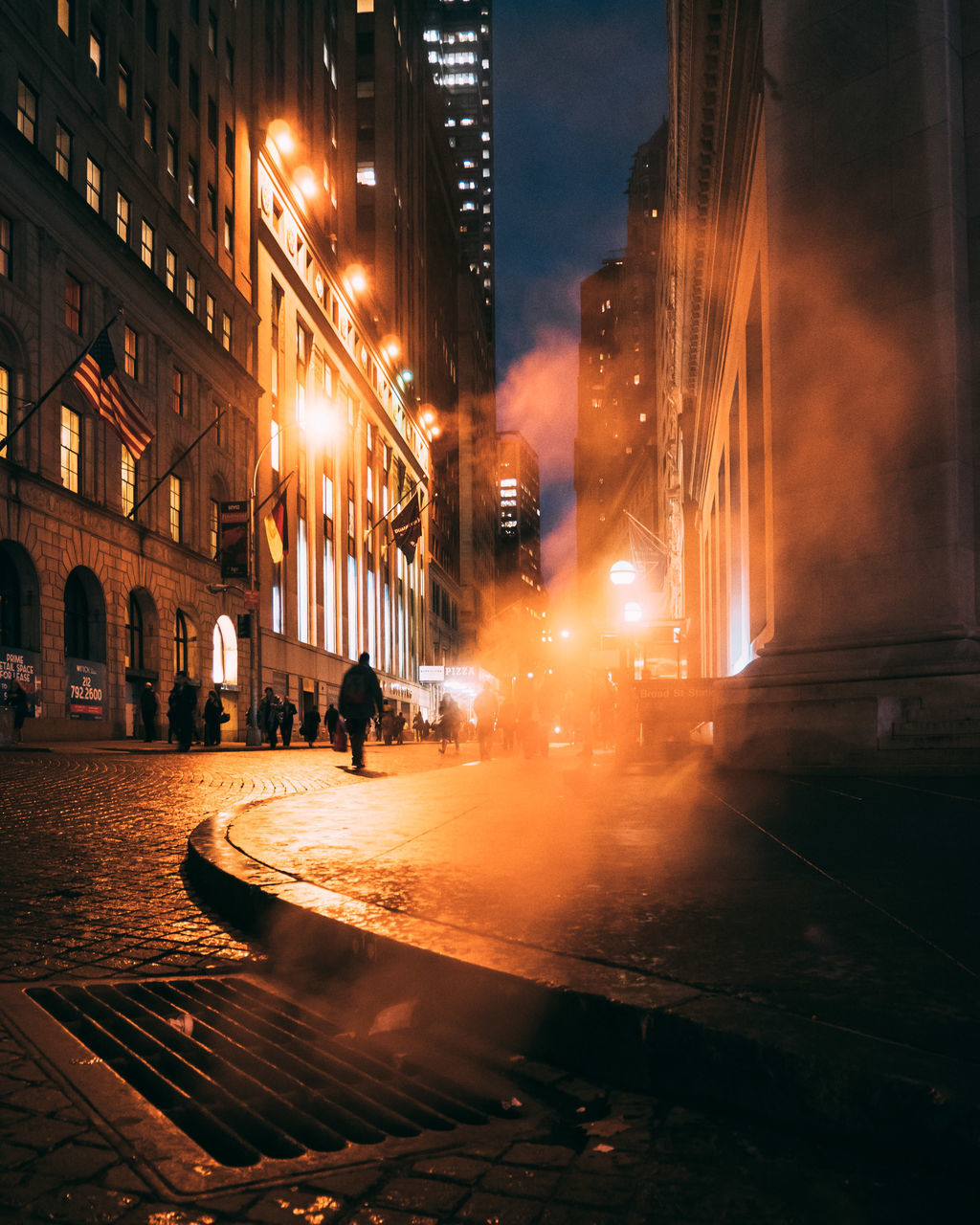 architecture, building exterior, built structure, illuminated, night, water, street, city, outdoors, wet, real people, transportation, long exposure, motion, spraying, men, sky, people