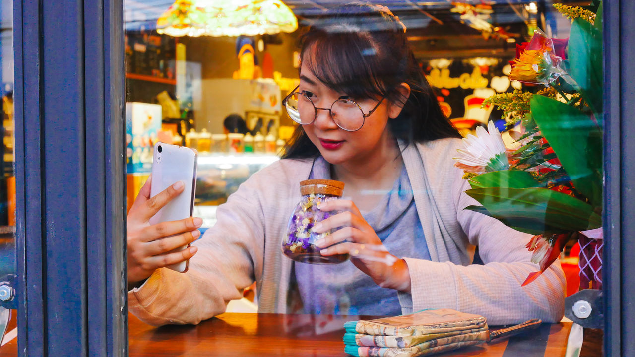 Mellow Cafe At Chiang Rai Adult Adults Only Bottle Day Eyeglasses  Front View Headshot Indoors  Laboratory One Person One Woman Only Only Women People Perfume Perfume Counter Retail  Scientific Experiment Store Young Adult