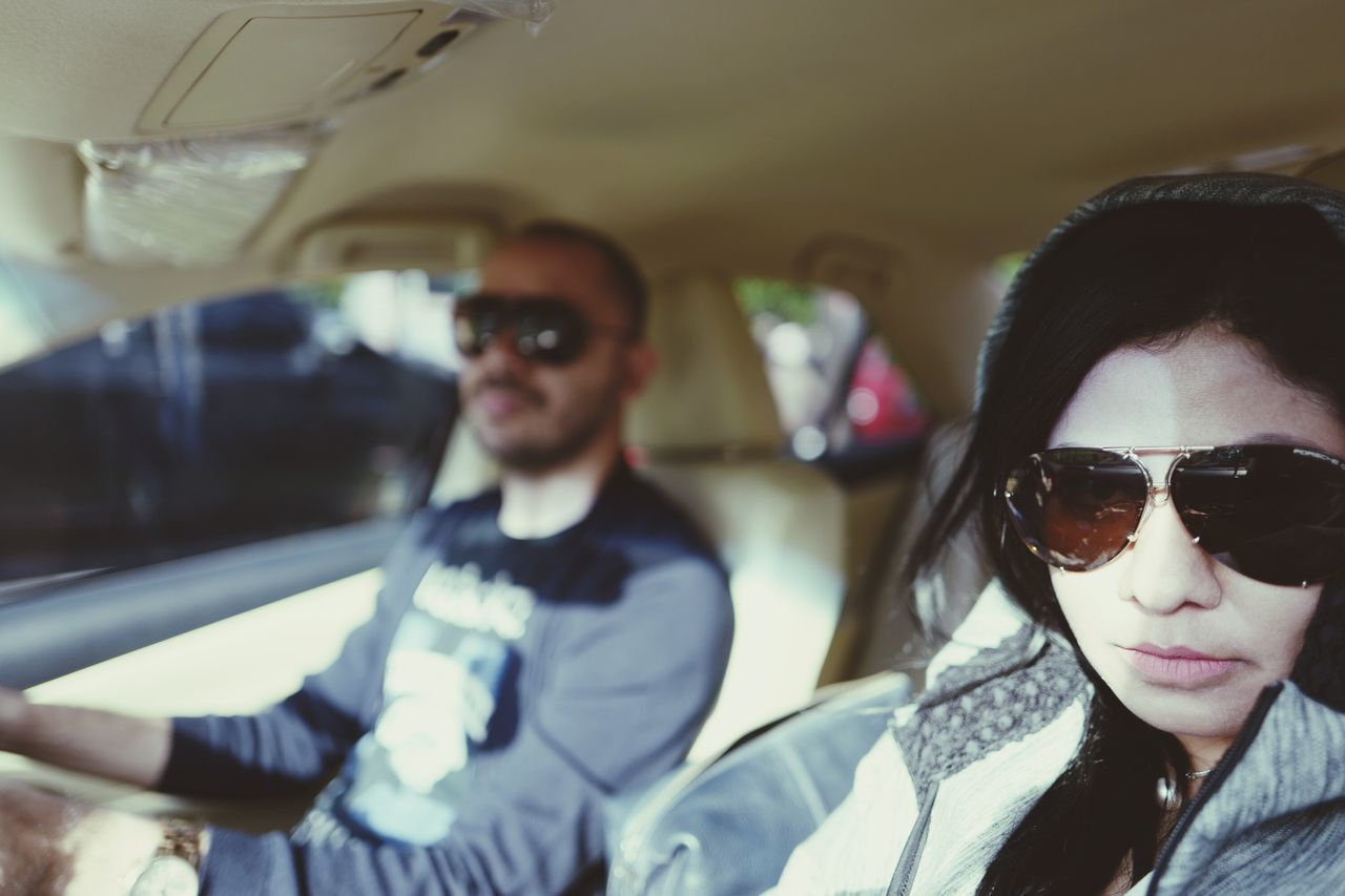 sunglasses, looking at camera, two people, real people, young women, front view, young adult, transportation, car, togetherness, portrait, lifestyles, young men, day, leisure activity, love, car interior, focus on foreground, girls, headshot, women, men, outdoors, close-up, people