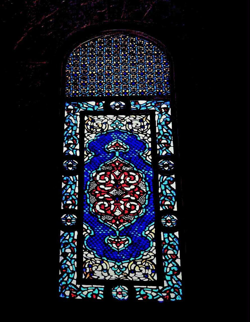 stained glass, window, design, art and craft, multi colored, pattern, place of worship, religion, spirituality, history, blue, indoors, no people, black background, close-up, day, architecture